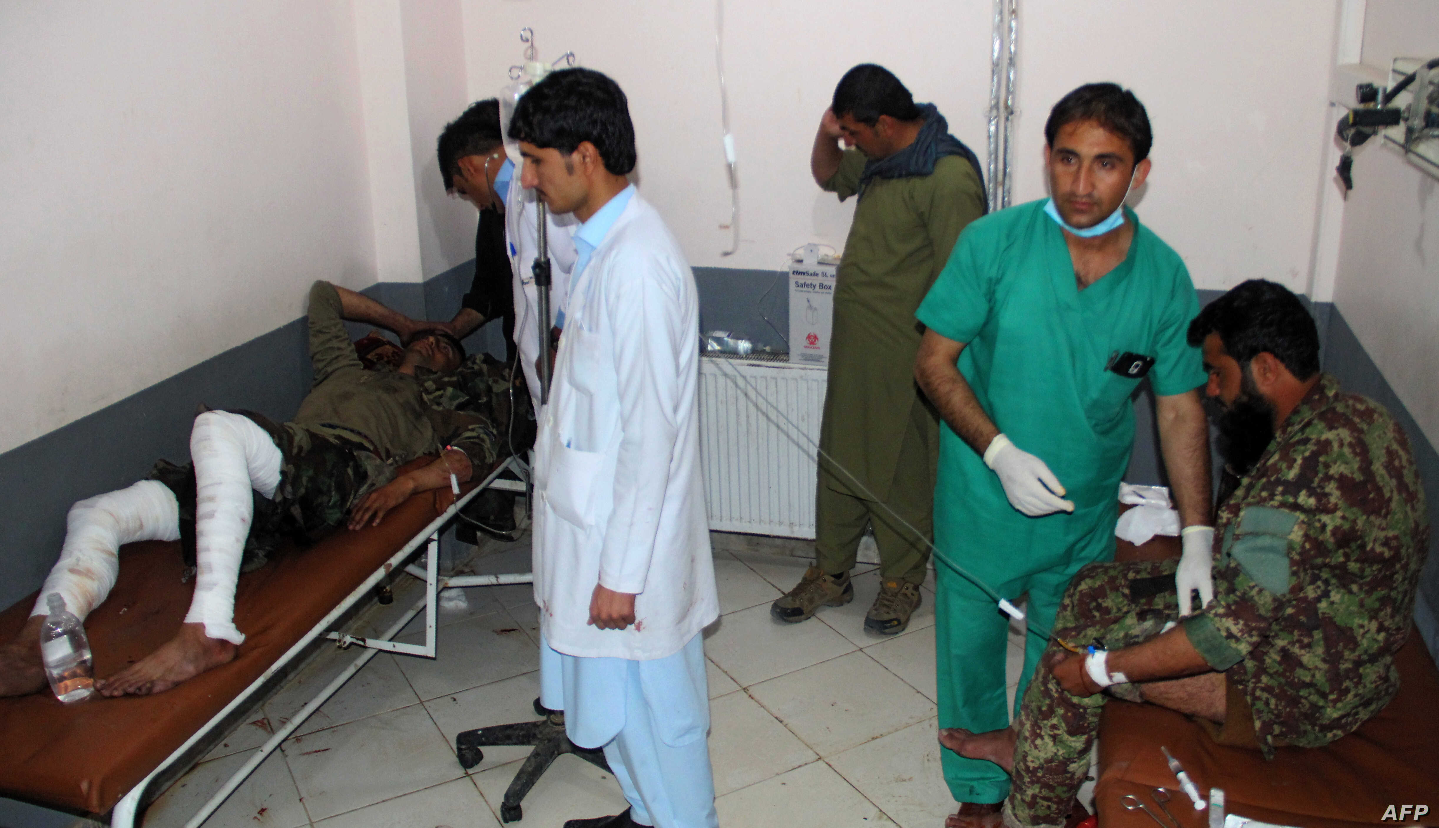 Wounded Afghan National Army (ANA) soldiers receive treatment in a hospital after a suicide bomber blew himself up inside a packed mosque on an Afghan army base in Khost province, Nov. 23, 2018.