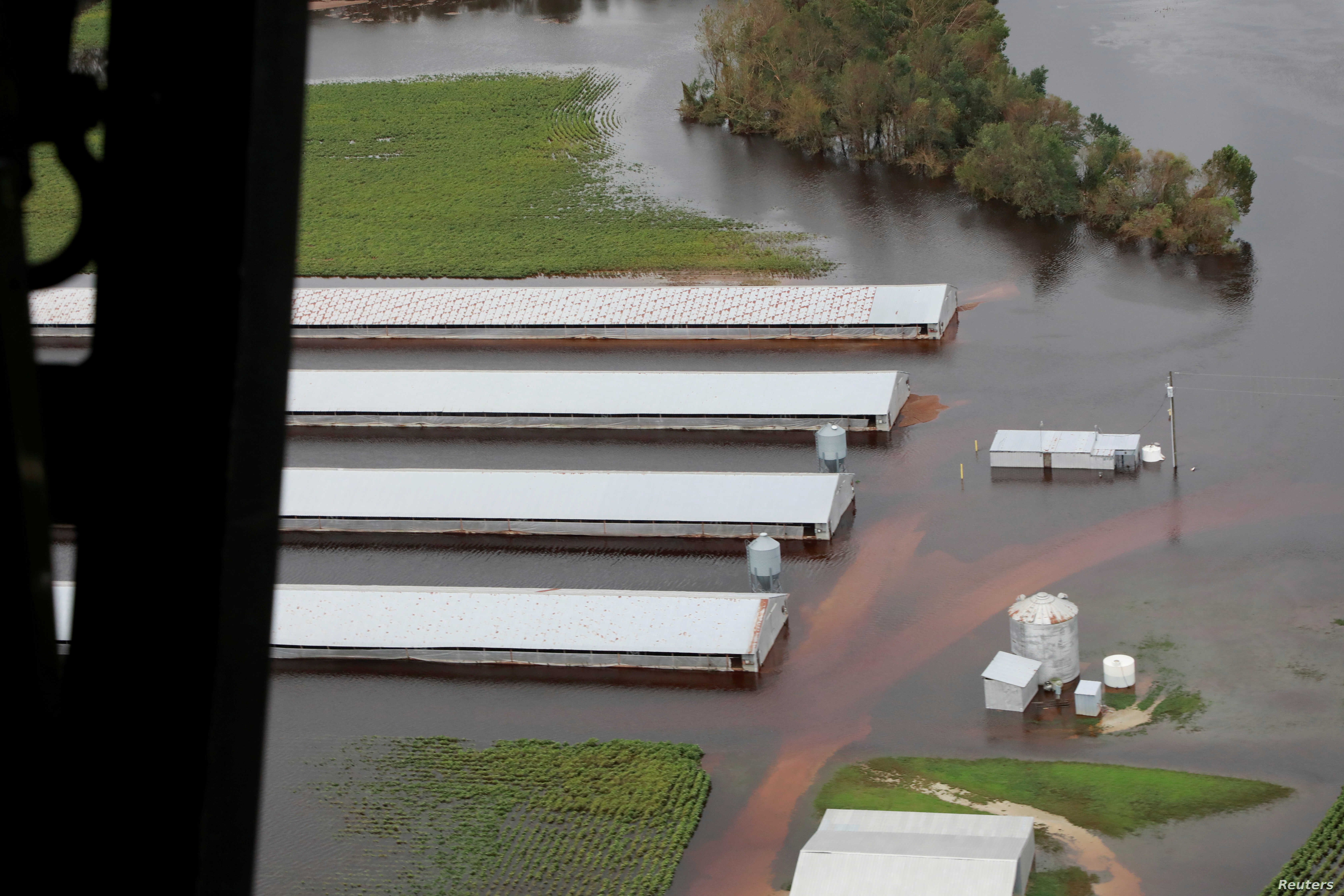 FILE - A flooded farm is seen during a flight by a U.S. Customs and Border Protection helicopter after the passing of Hurricane Florence, now downgraded to a tropical depression, over central North Carolina, Sept. 16, 2018.
