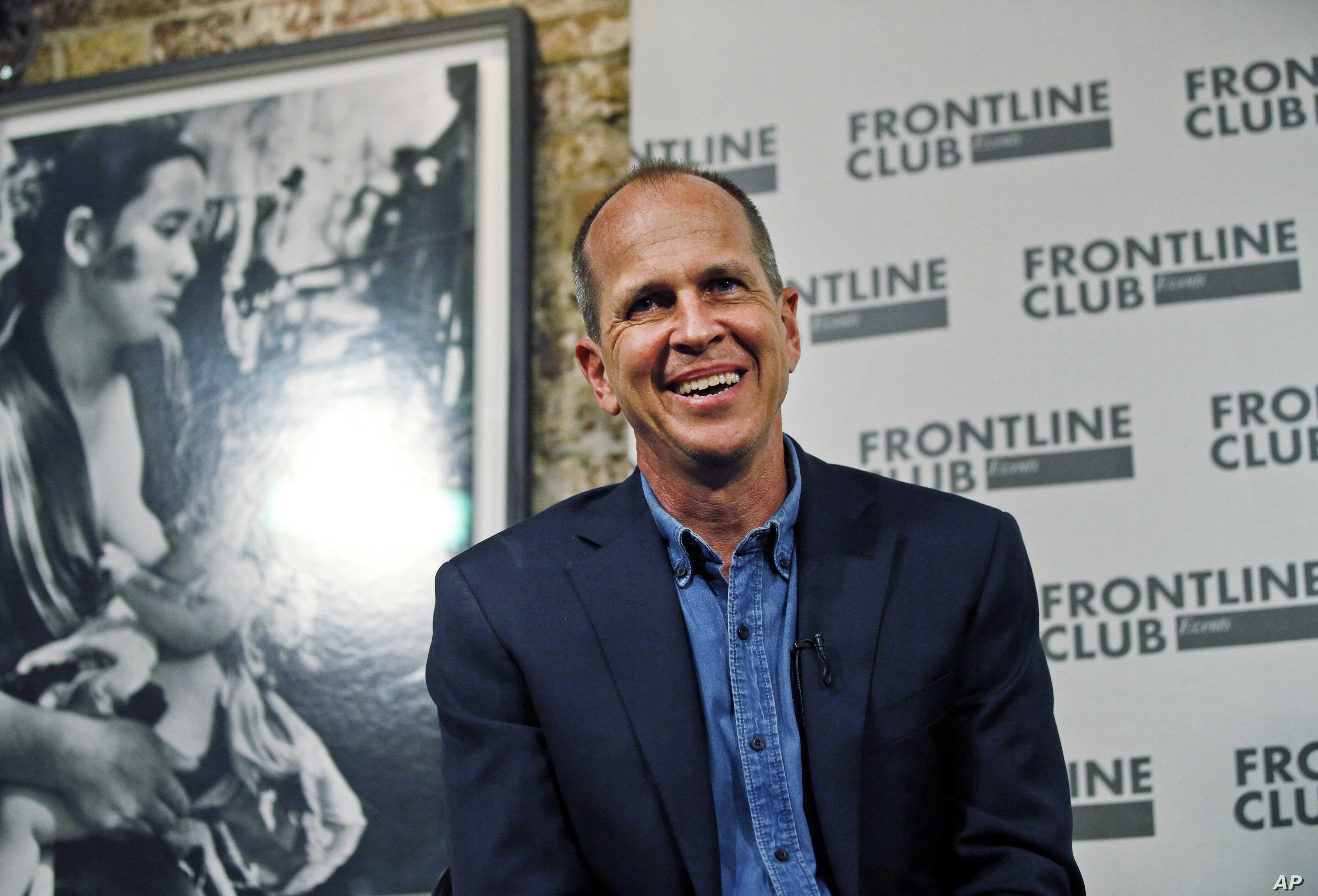 FILE - Freed Al Jazeera journalist Peter Greste smiles as he answers a question during an event in central London, Feb. 19, 2015.