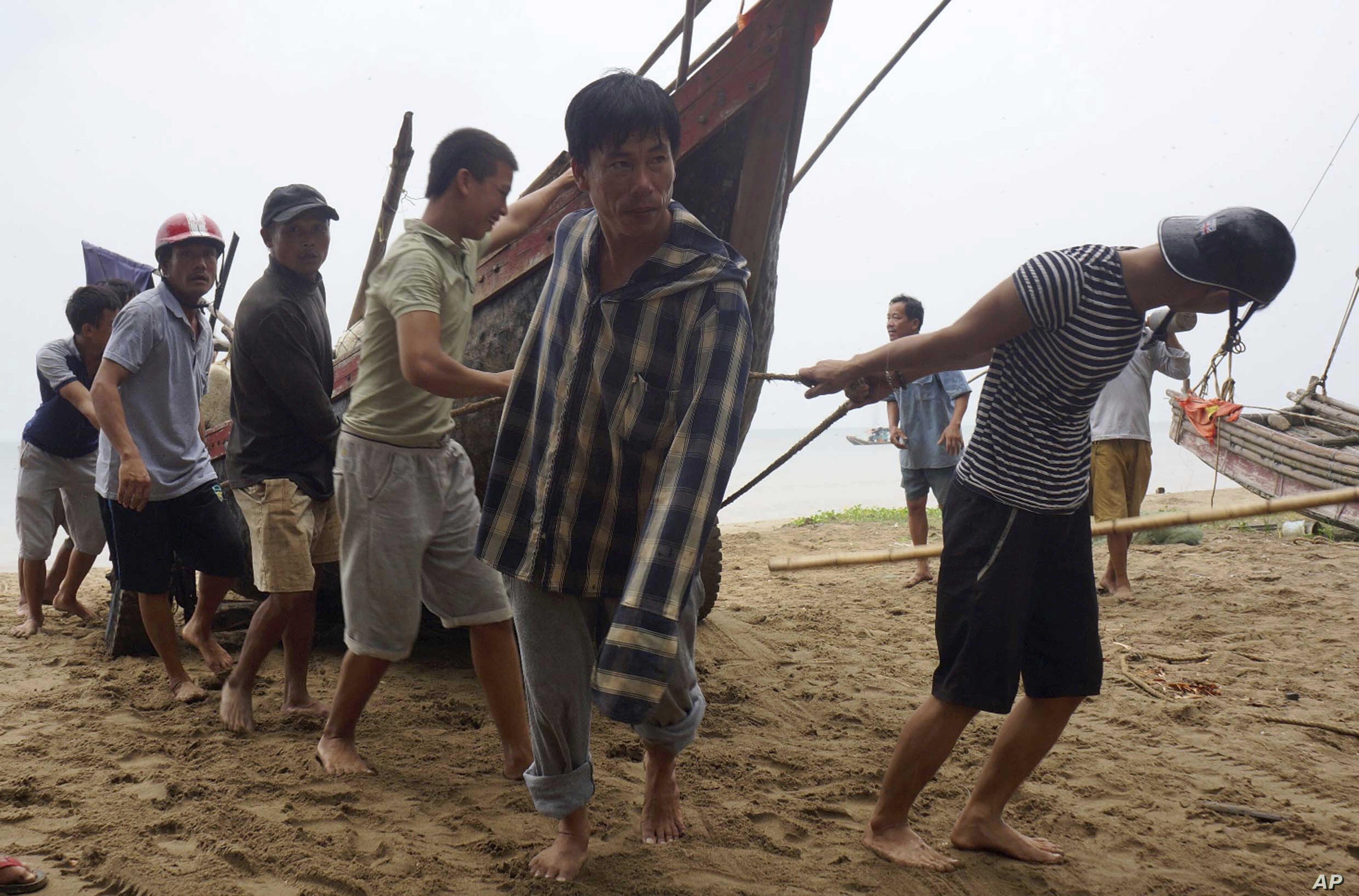 Vietnamese villagers move a fishing boat on shore in northern Thanh Hoa province, Vietnam, Sept. 14, 2017. Vietnam  braced Thursday for Typhoon Doksuri, which was expected to be the most powerful tropical cyclone to hit the Southeast Asian country in...