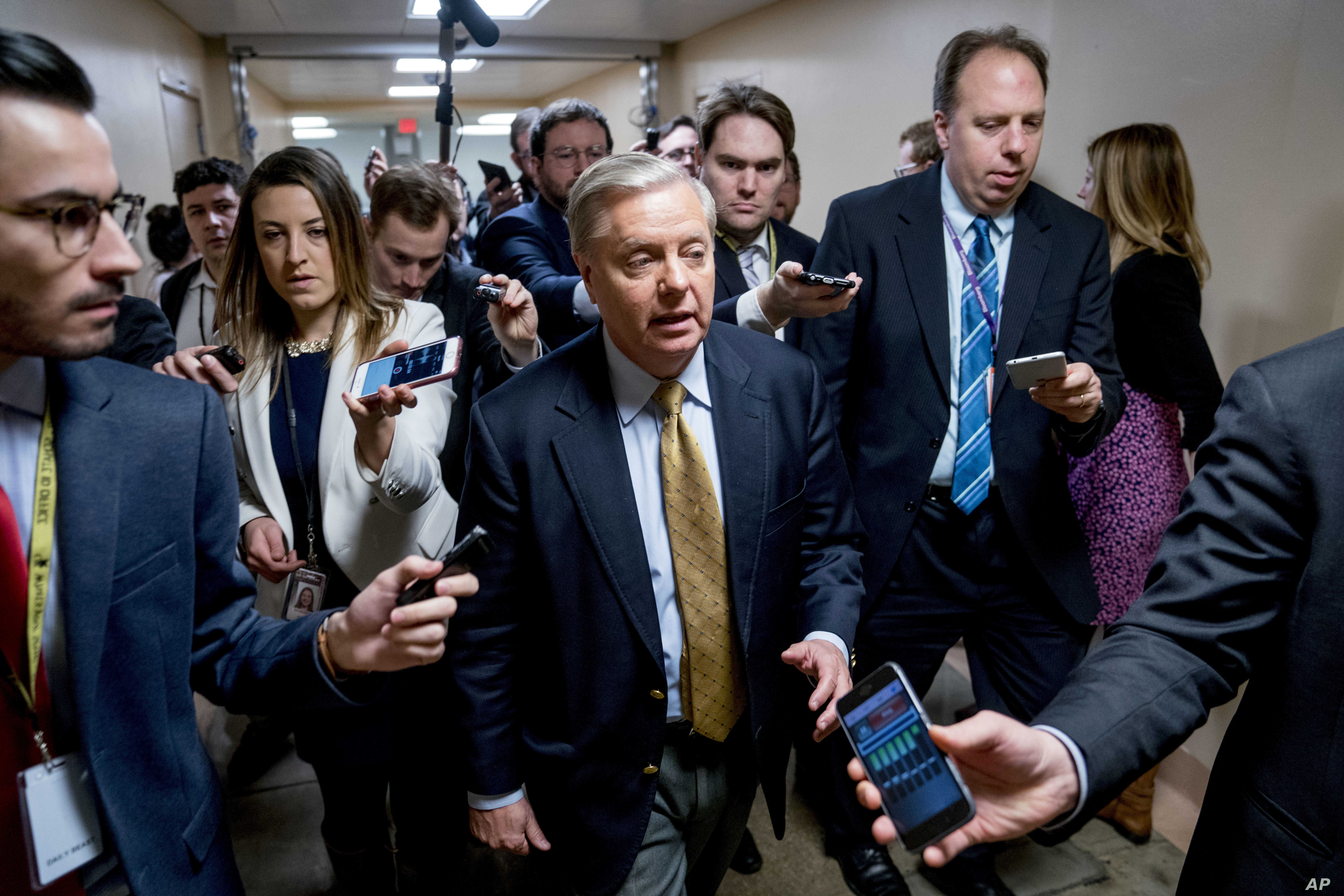 Sen. Lindsey Graham, R-S.C., speaks to reporters as he walks toward the Senate as Congress moves closer to the funding deadline to avoid a government shutdown on Capitol Hill in Washington, Jan. 18, 2018.
