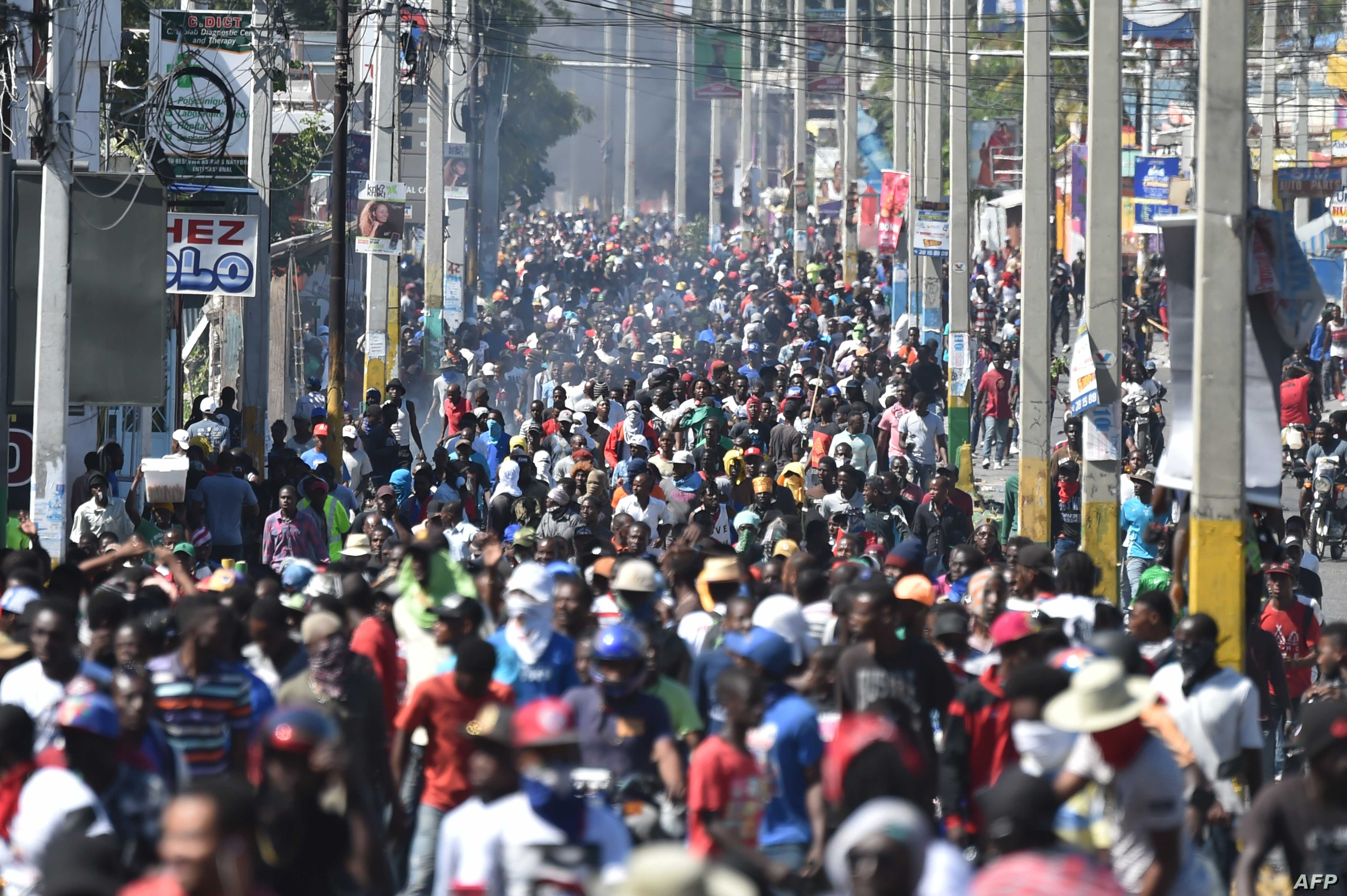 Demonstrators march on the streets on the fifth day of protests in Port-au-Prince, Feb. 11, 2019, against Haitian President Jovenel Moise and the misuse of PetroCaribe funds.