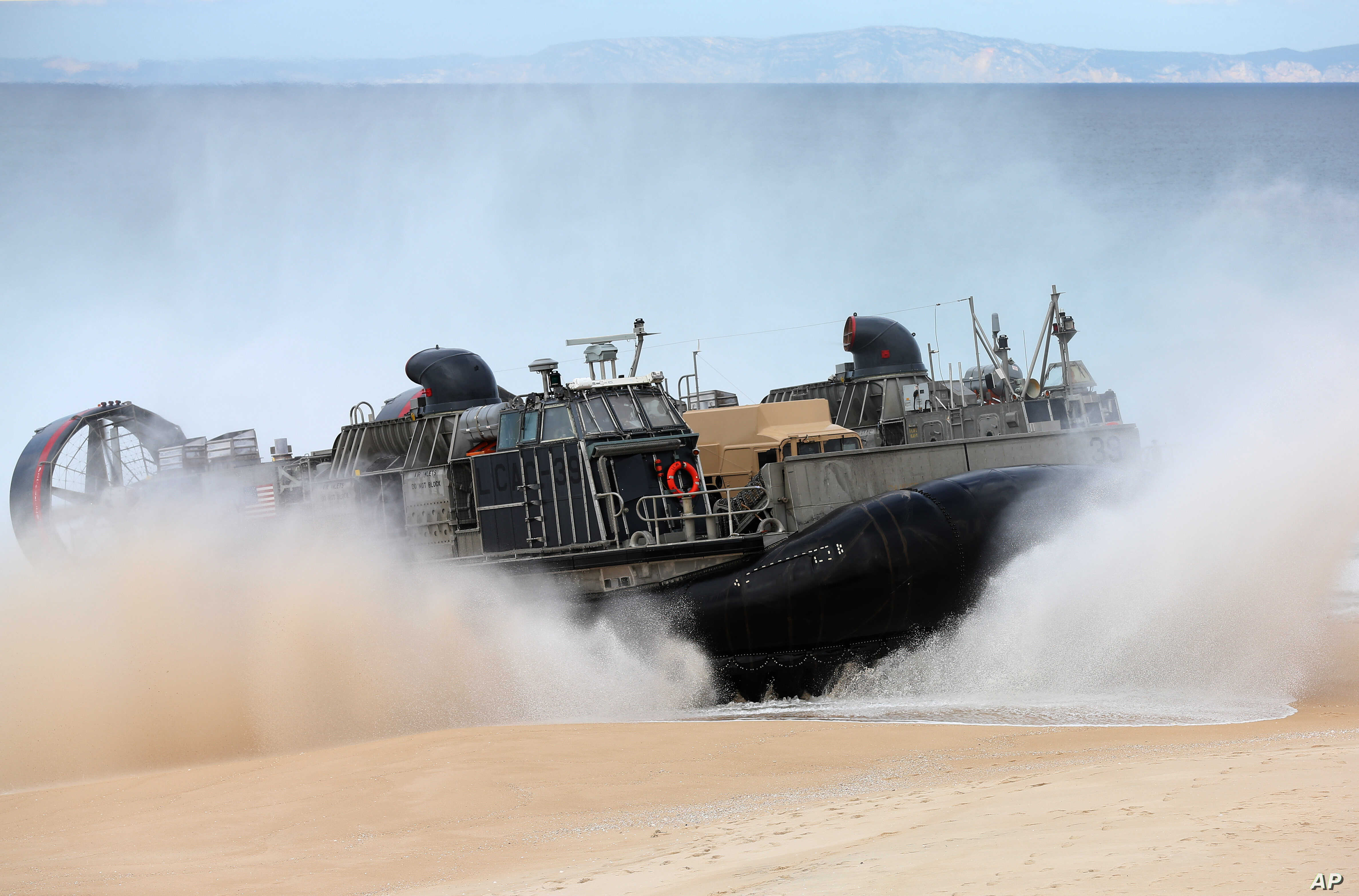A US Navy hovercraft approaches the beach at the beginning of the NATO Trident Juncture exercise 2015 at Raposa Media beach in Pinheiro da Cruz, south of Lisbon, Oct. 20, 2015.