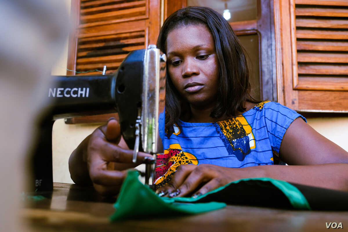 """Adele dos Santos, pictured here in Bissau, Guinea Bissau, Nov. 22, 2018, says her orders have increased since she she joined the """"Young Women Entrepreneurs"""" group. (R. Shryock for VOA)"""
