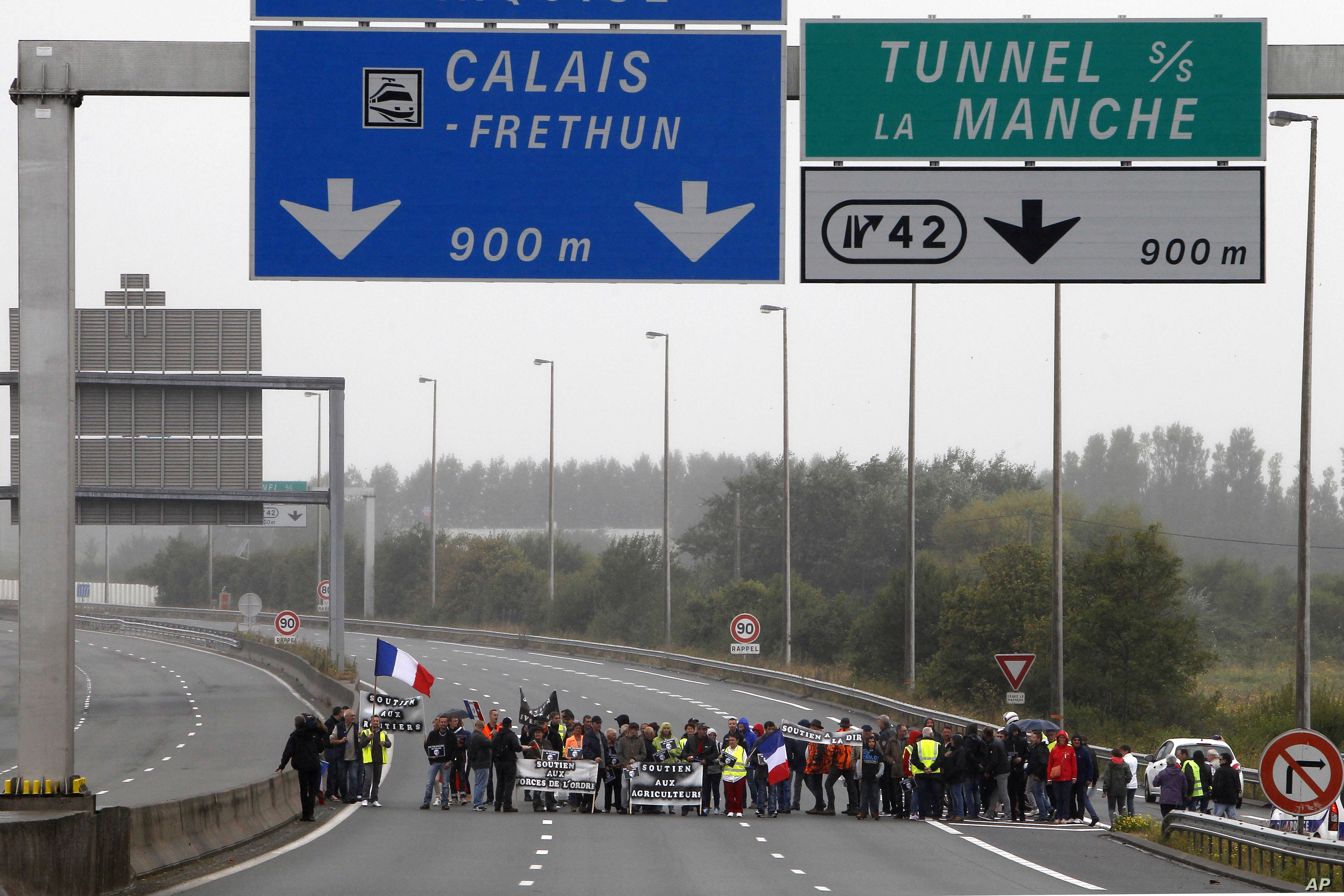 People block the highway leading to Calais and the Channel tunnel in Calais, northern France, Sept. 5, 2016.
