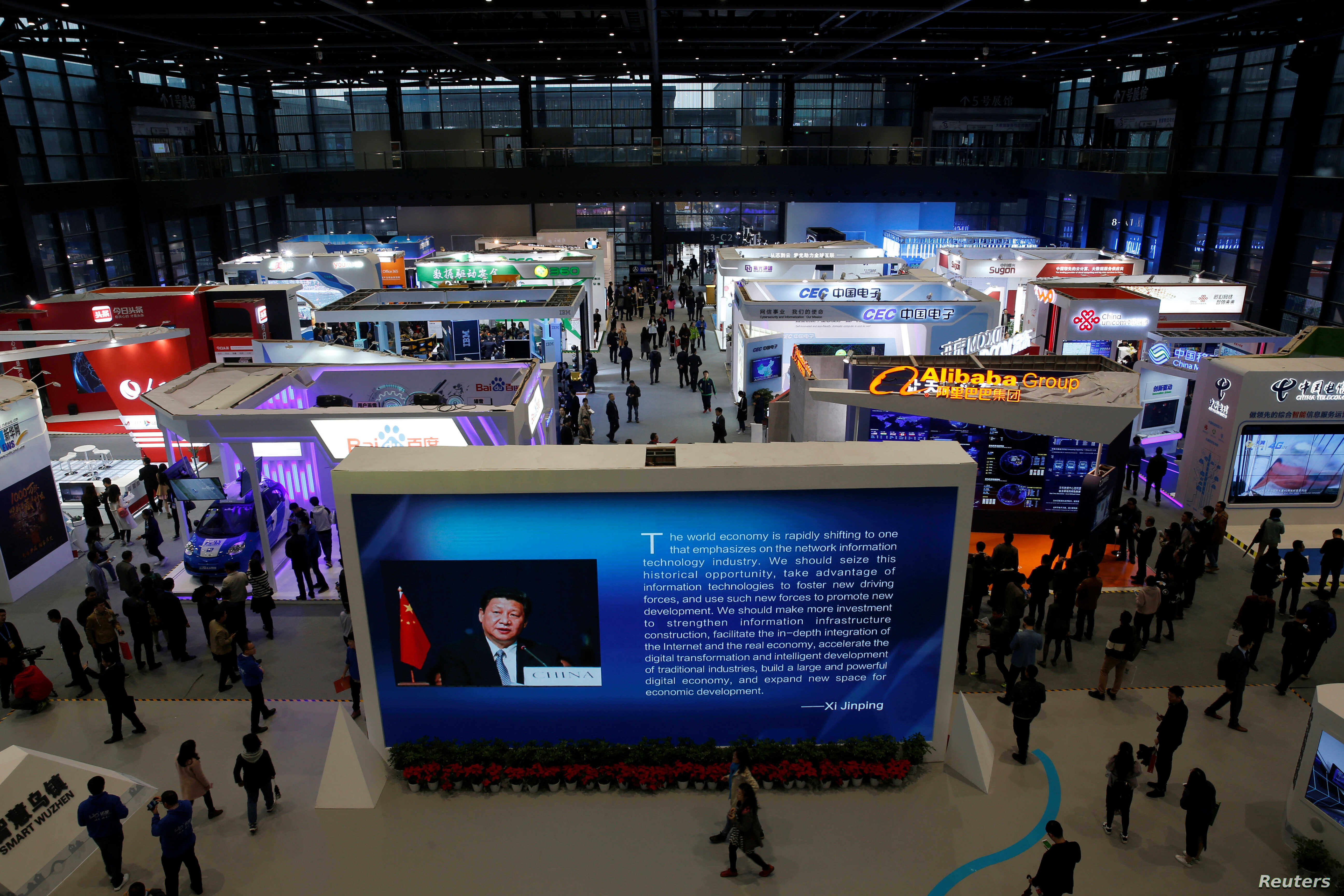 FILE - China's President Xi Jinping is shown on a screen in front of logos of China's leading internet companies during the World Internet Conference in Wuzhen town of Jiaxing, Zhejiang province, China, Nov. 17, 2016.
