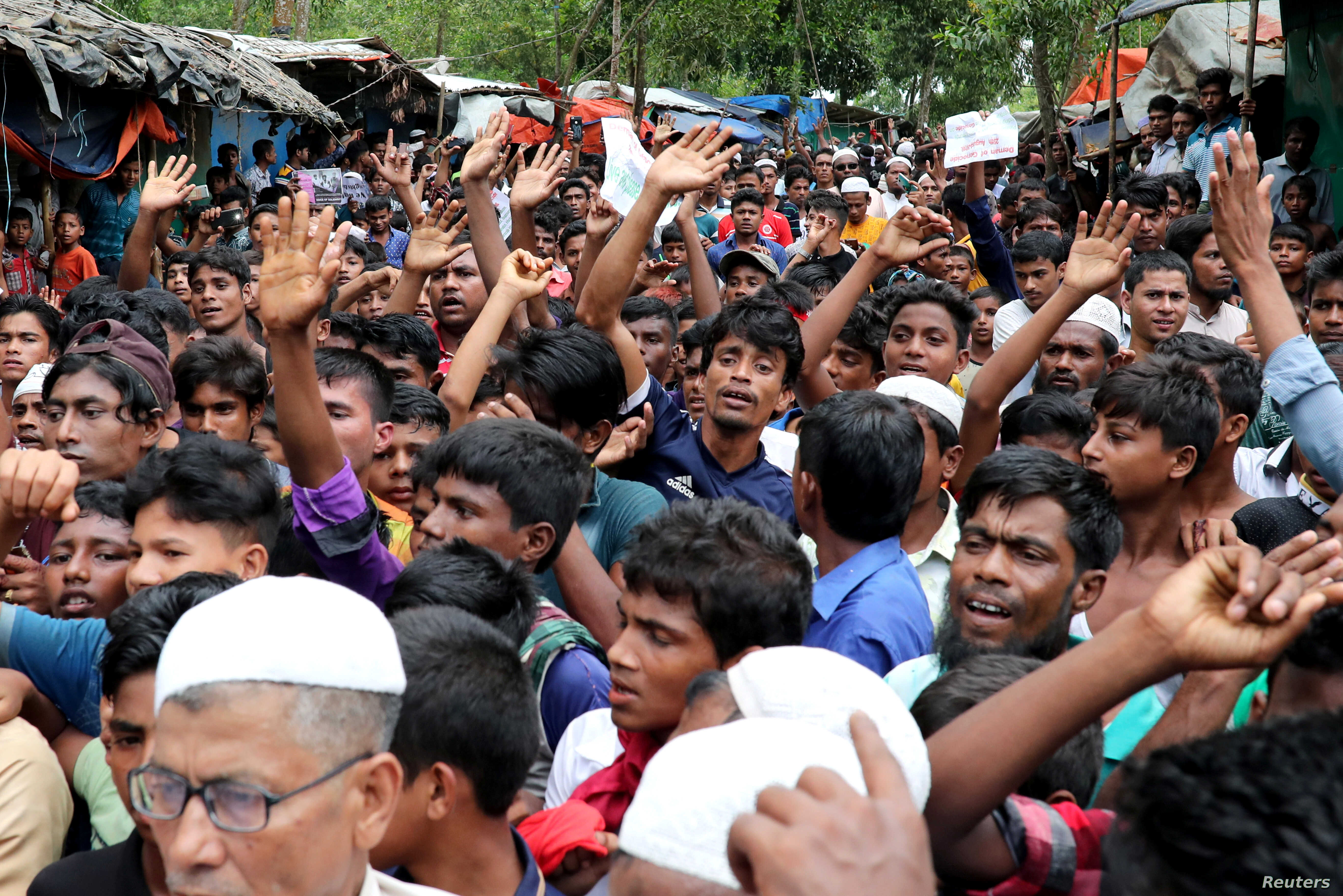 Rohingya refugees shout slogans as they take part in a protest at the Kutupalong refugee camp to mark the one-year anniversary of their exodus, in Cox's Bazar, Bangladesh, Aug. 25, 2018.
