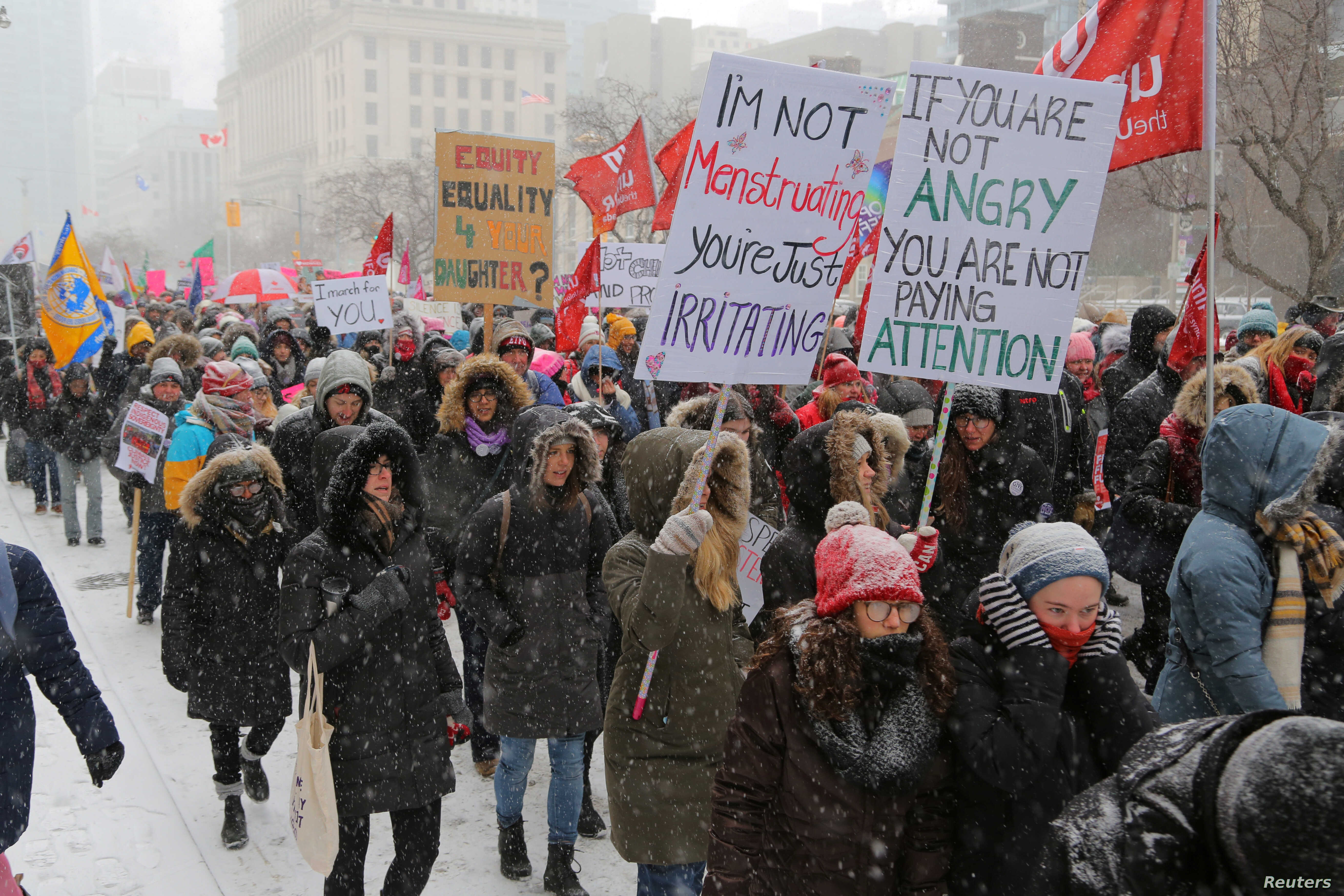 Participants walk to the Ontario provincial legislature during the Women's March in a -22 Celsius (8 Fahrenheit) wind chill snowstorm in Toronto, Ontario, Jan. 19, 2019.