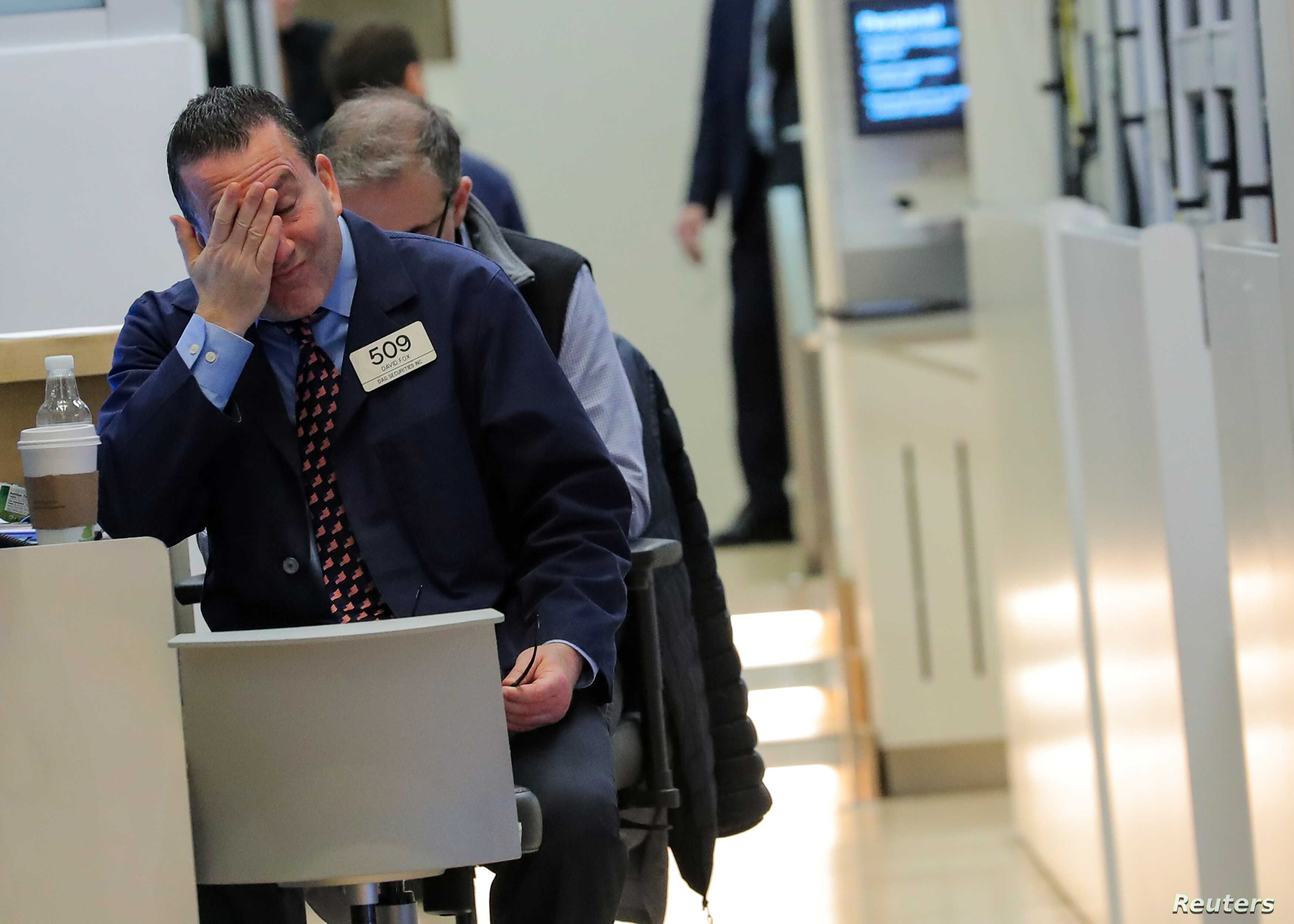 Traders who work on the floor of the New York Stock Exchange in New York, Dec. 14, 2018, react to a tough day as stocks fell sharply.