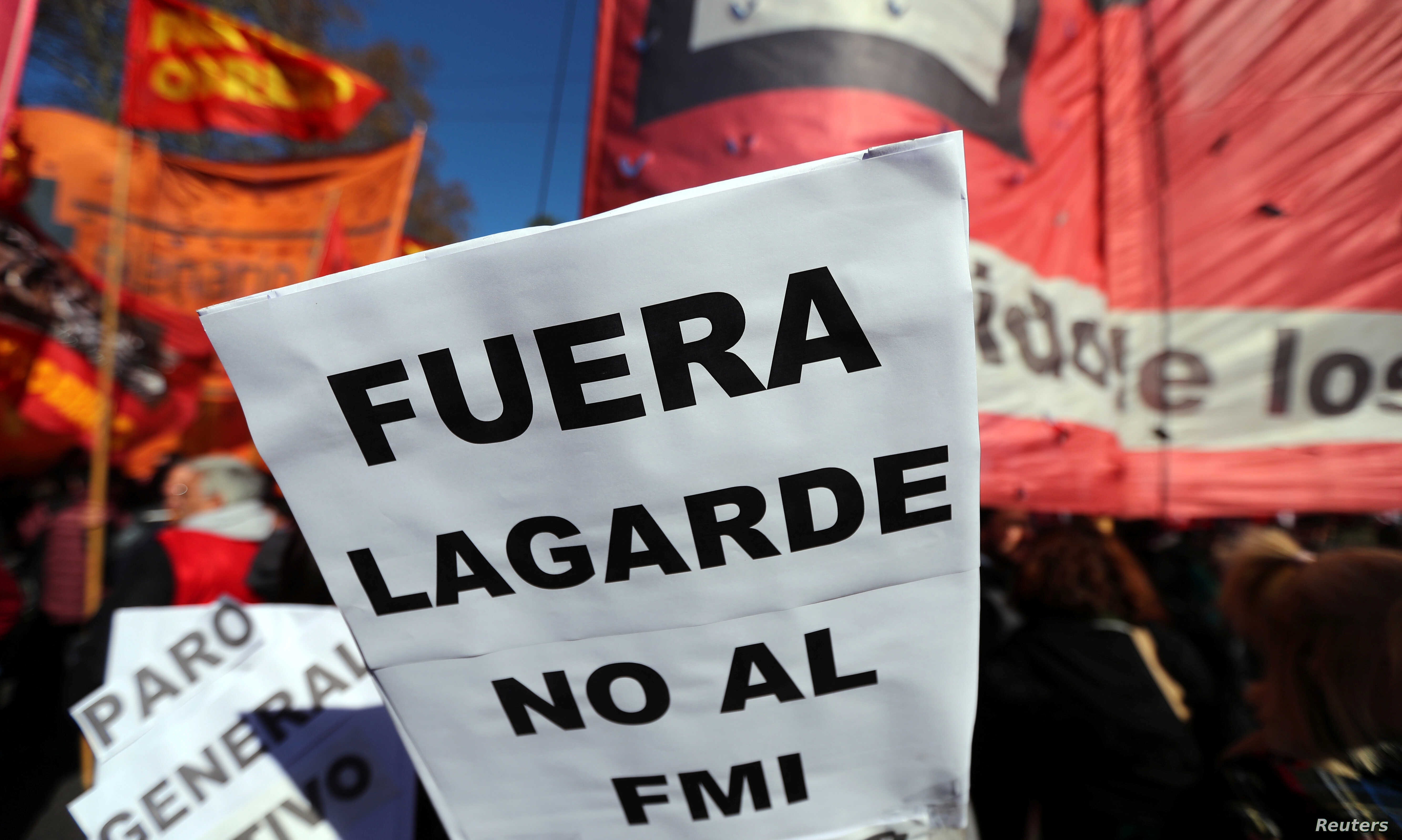 """A sign that reads """"(Christine) Lagarde, get out - No to the IMF (International Monetary Fund)"""" is seen during a protest against the G-20 meeting of finance ministers in Buenos Aires, Argentina, July 21, 2018."""