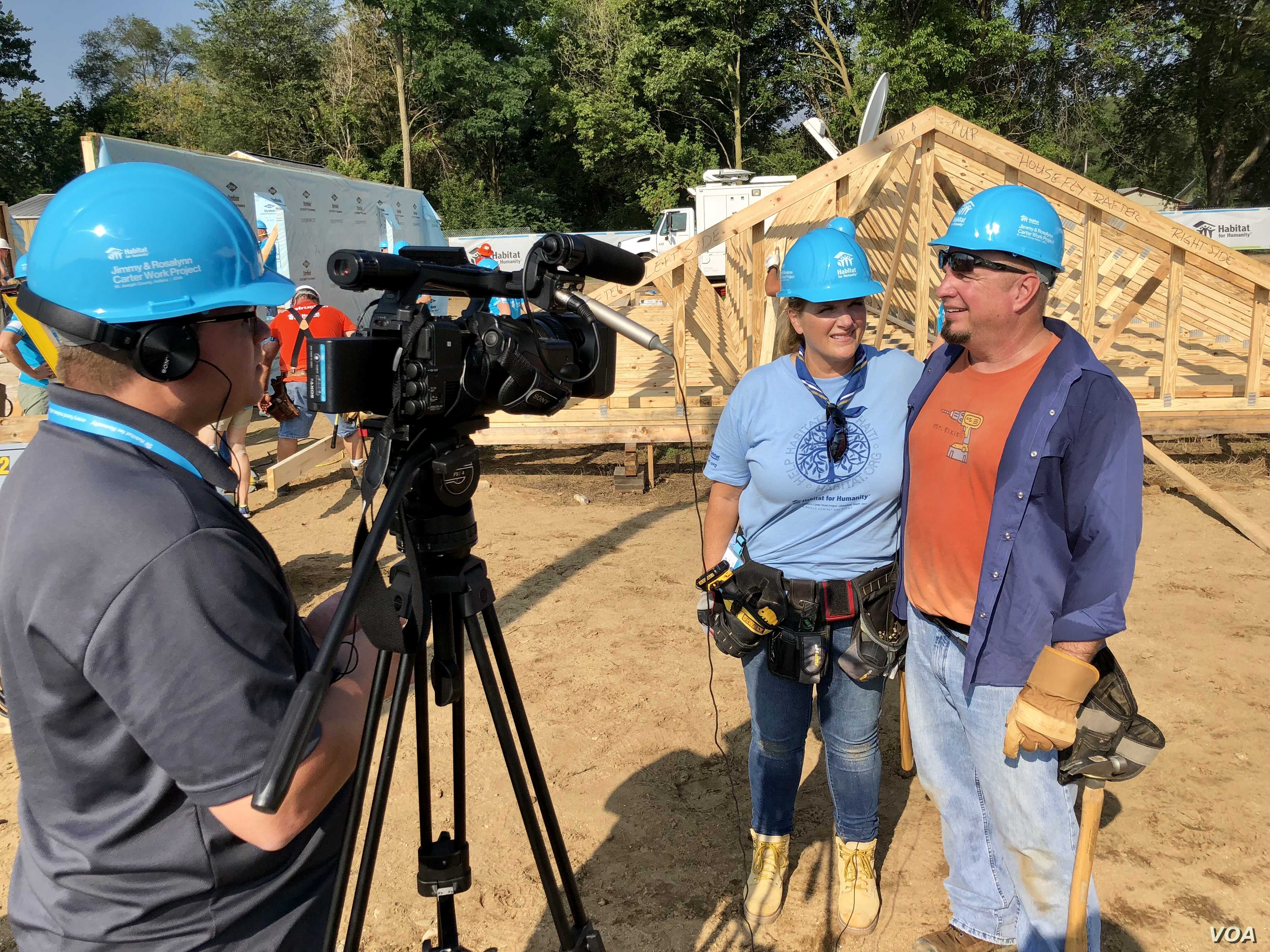 Country music icons Garth Brooks and Trisha Yearwood are just two volunteers among hundreds in what is a massive volunteer effort on the outskirts of South Bend, Ind., to build nearly two dozen homes.