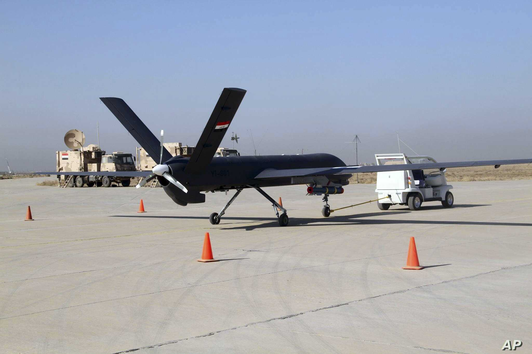 FILE - The first drone to be used by the Iraqi Air Force, loaded with ordnance, prepares to take-off to raid Islamic State group positions at an airbase in Kut, 160 kilometers southeast of Baghdad, Iraq, Oct 10, 2015.