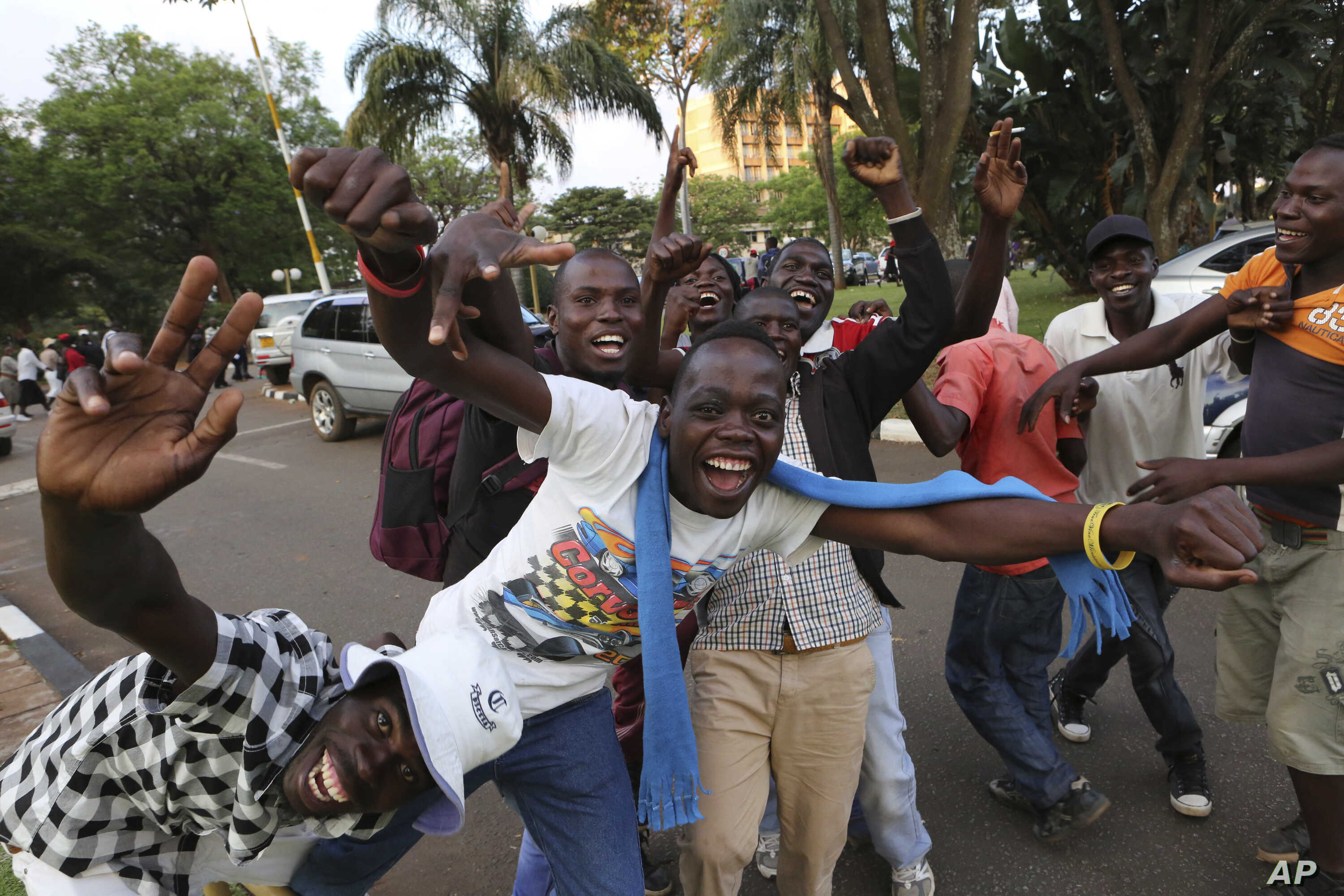 Zimbabweans celebrate in Harare, Nov, 21, 2017, after the resignation of President Robert Mugabe.