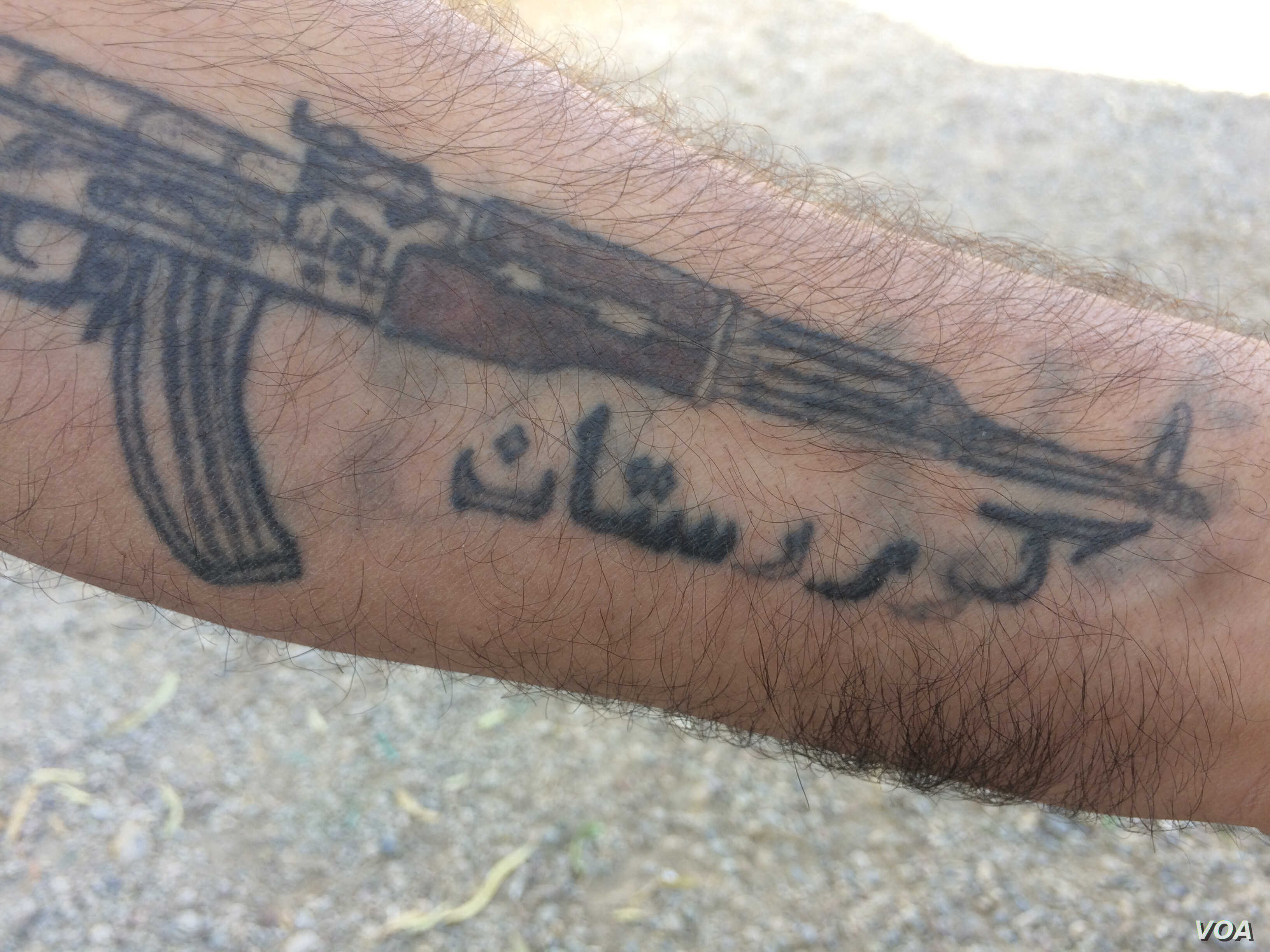 """A man shows his tattoo that reads """"Kurdistan"""" and says he, like other Kurds, still dream of an independent state on Oct. 17, 2017. (H.Murdock/VOA)"""