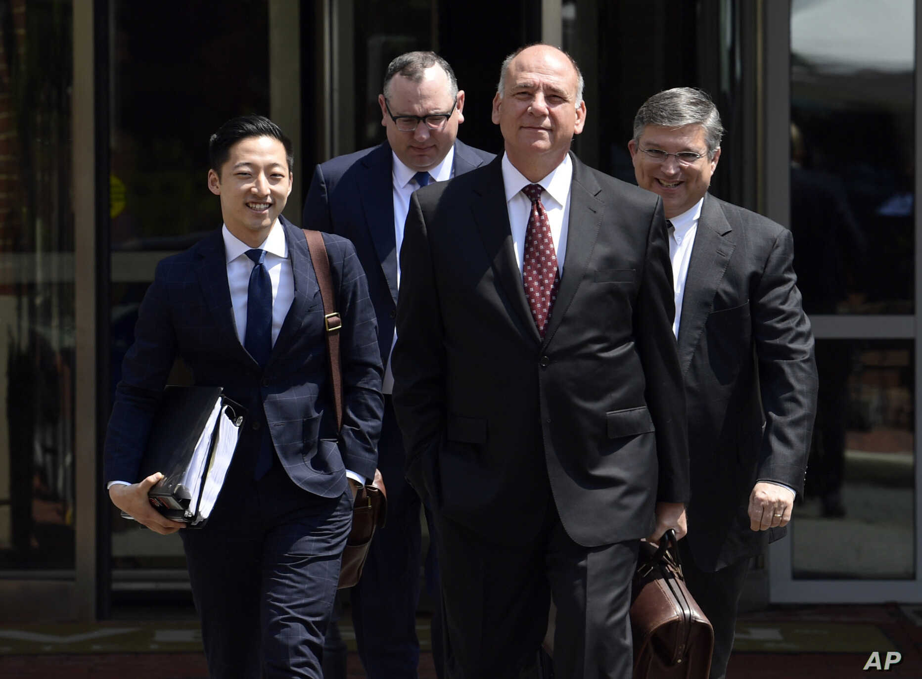 Thomas Zehnle (2nd-R), attorney for Paul Manafort, President Donald Trump's former campaign chairman, walks with other members of the defense team to Alexandria Federal Courthouse in Alexandria, Va., Aug. 6, 2018.