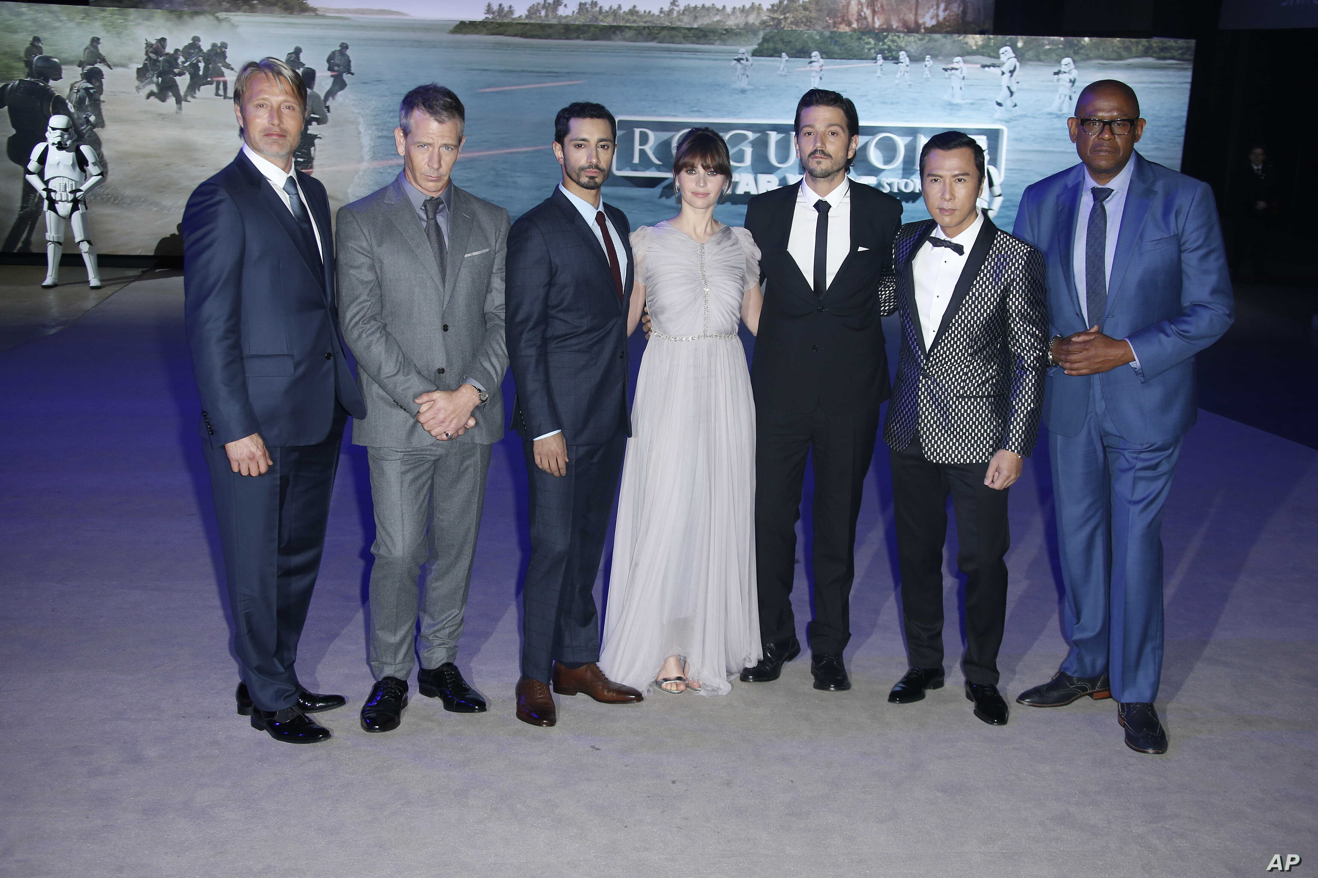 Actors from left, Mads Mikkelsen, Ben Mendelsohn, Riz Ahmed, Felicity Jones, Diego Luna, Donnie Yen and Forest Whitaker pose for photographers upon arrival at the Rogue One: A Star Wars premiere in London, Dec. 13, 2016.