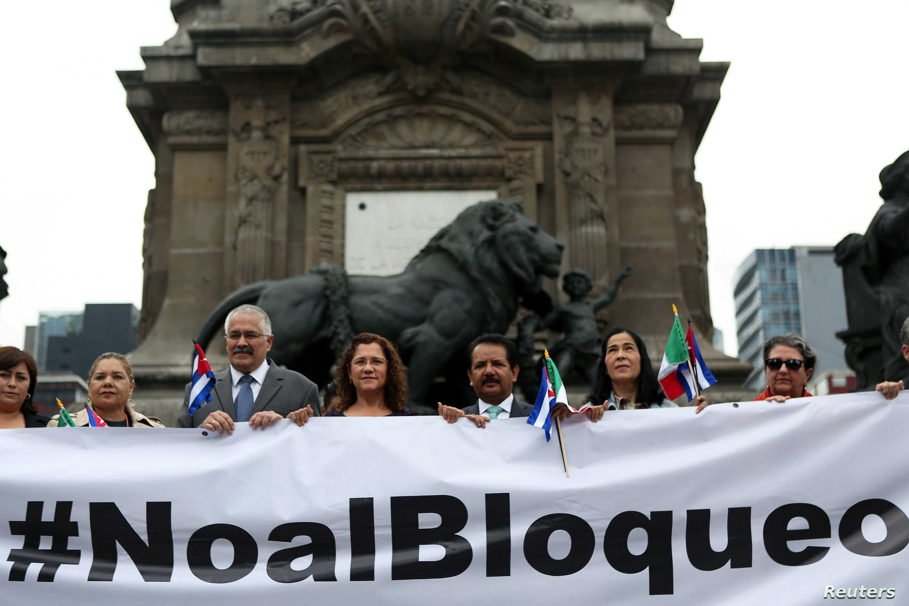 Dagoberto Rodriguez, Cuba's ambassador in Mexico, takes part with members of the Mexico-Cuba Friendship Group of the Chamber of Deputies during a demonstration against the trade embargo on Cuba by the U.S. at Angel de la Independencia monument in Mex...