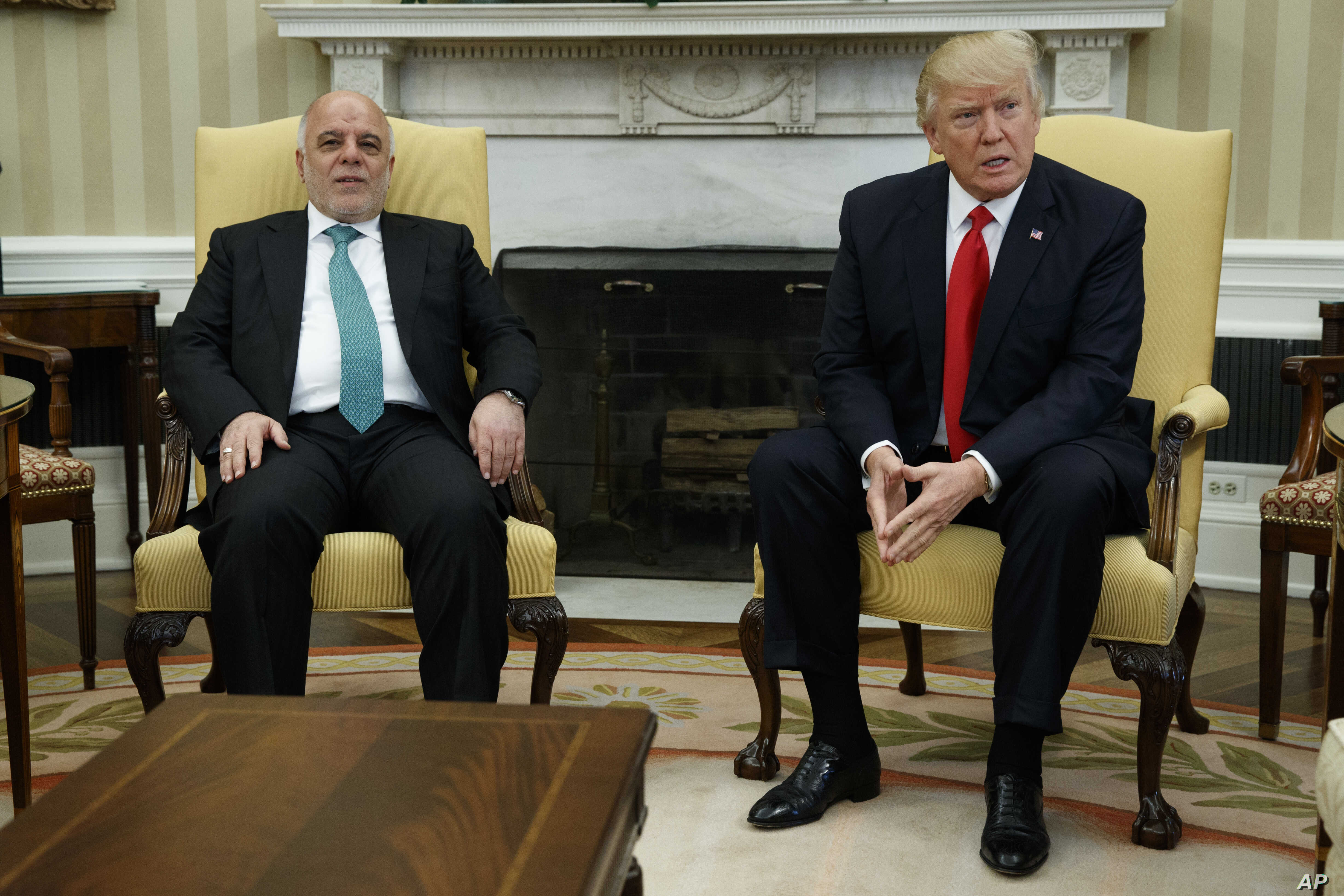 President Donald Trump meets with Iraqi Prime Minister Haider al-Abadi in the Oval Office of the White House in Washington, March 20, 2017.