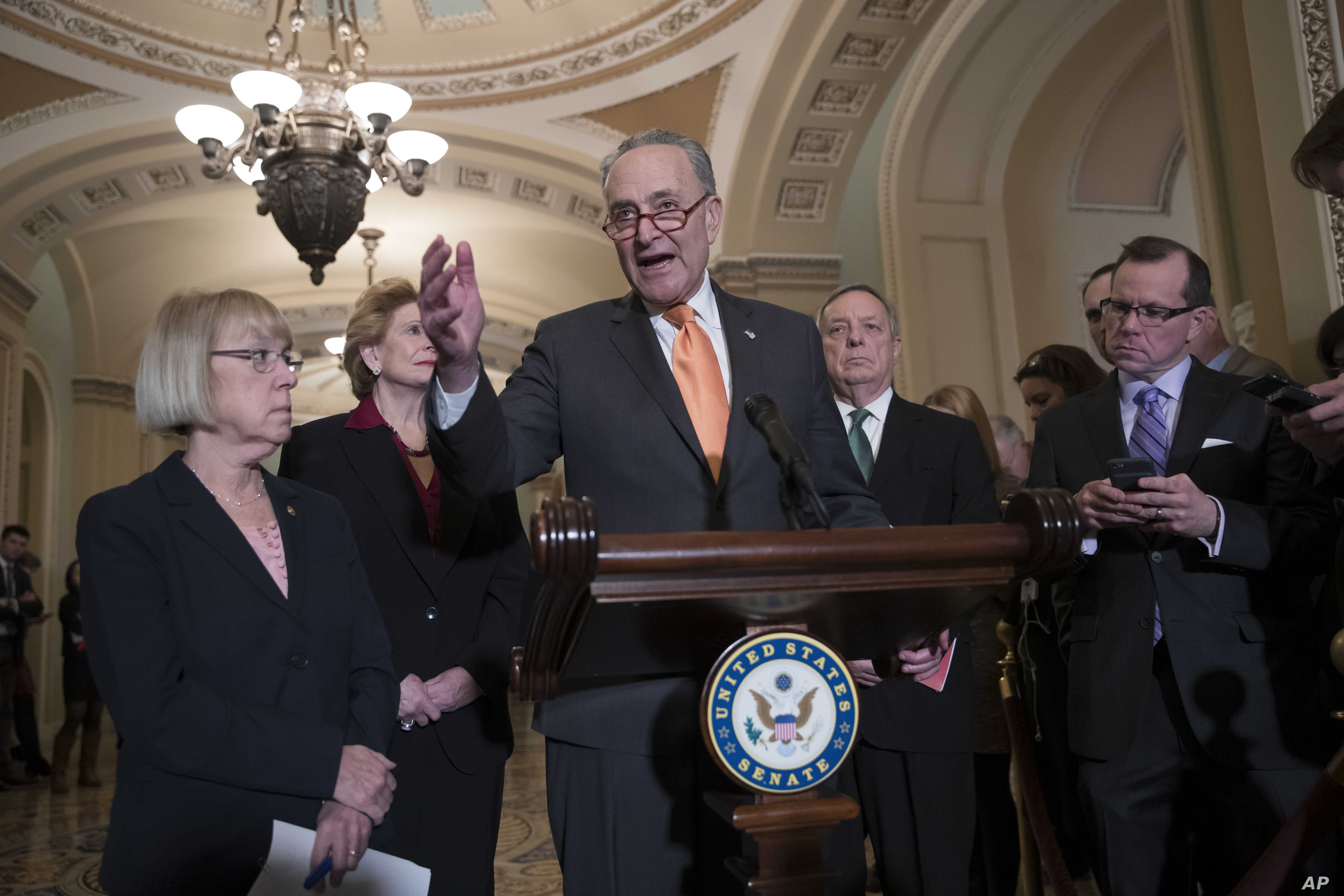 Senate Minority Leader Chuck Schumer, D-N.Y., Sen. Patty Murray, D-Wash., Sen. Debbie Stabenow, D-Mich., and Sen. Dick Durbin, D-Ill., the assistant Democratic leader, talks to reporters about the possibility of a partial government shutdown, at the ...