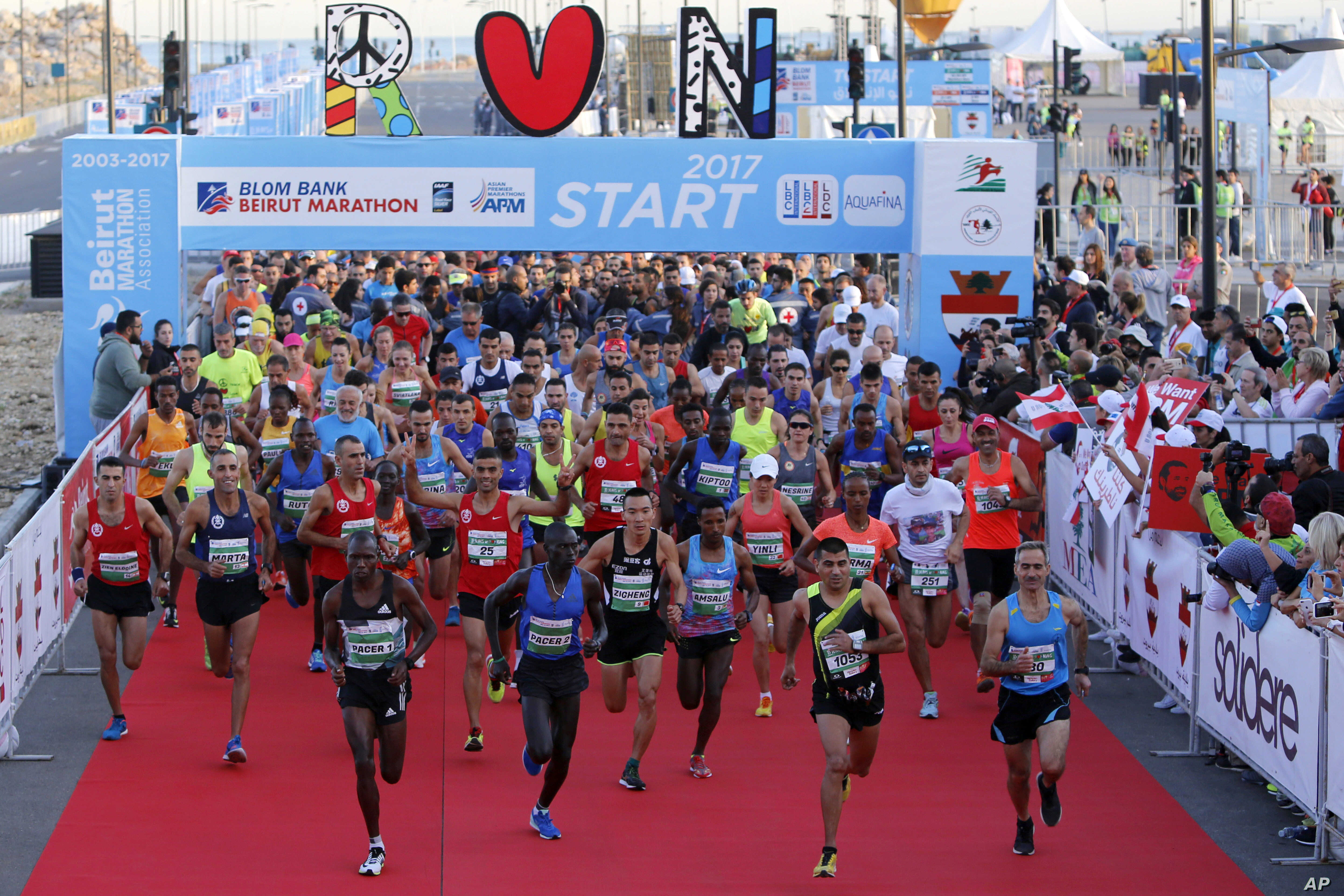 Runners compete in the Beirut Marathon, Sunday, Nov. 12, 2017. Absent from the marathon this year is the outgoing PM Saad Hariri, a regular participant, who resigned from his post unexpectedly last week while in Saudi Arabia.