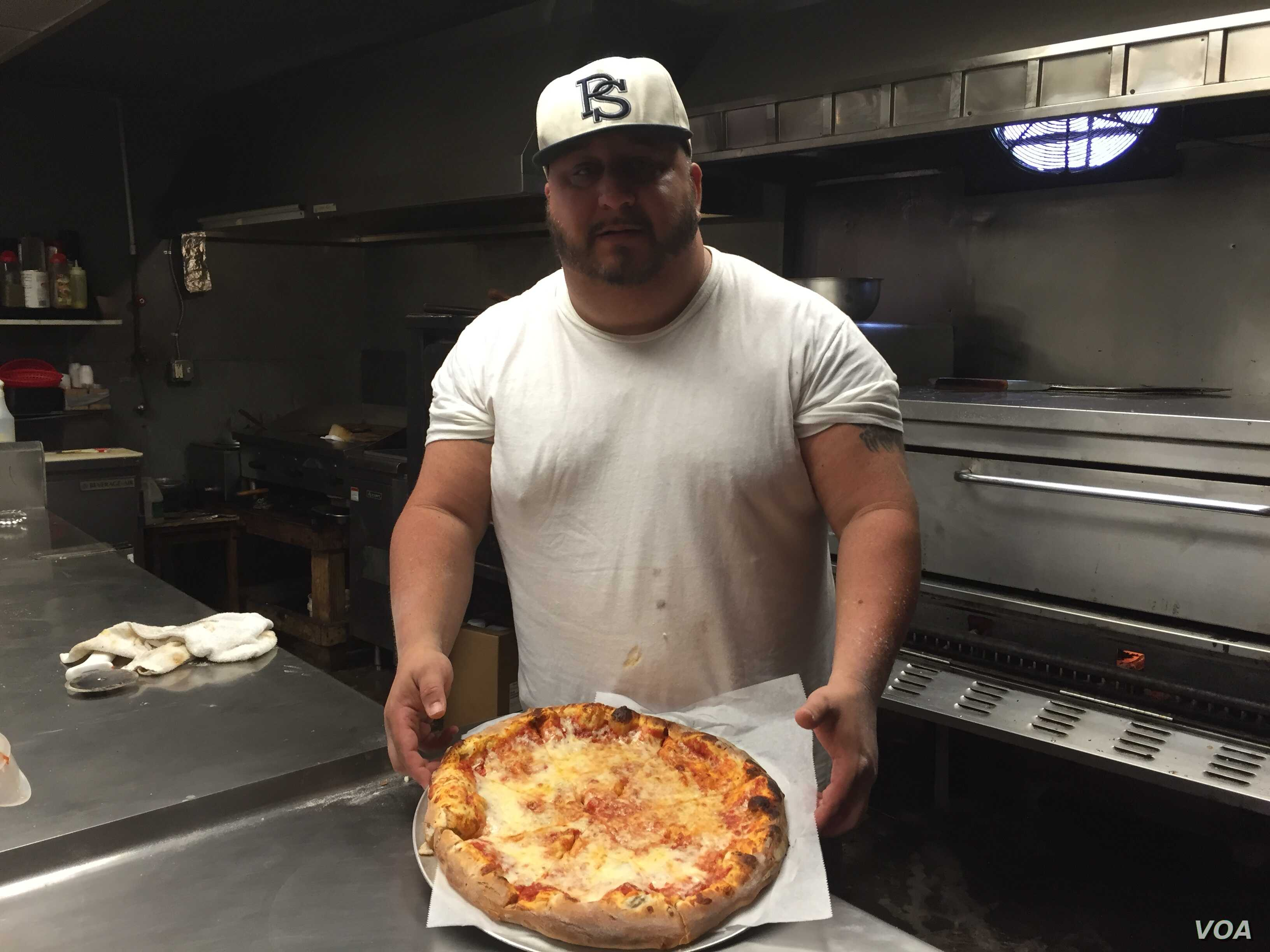 "Marty Coar Jr., who runs Two Brothers Pizza in Dunmore, Pennsylvania, made news during Democratic presidential candidate Hillary Clinton's last visit when he made what he called a ""Madam President"" pizza topped with hot sauce. (A. Pande/VOA)"