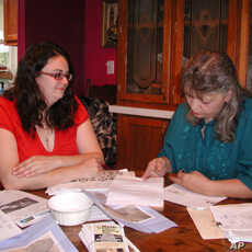 Kim McEvoy and Janet McIntyre, who feel their drinking water has been contaminated by nearby natural gas extraction, do some grassroots organizing around the kitchen table.