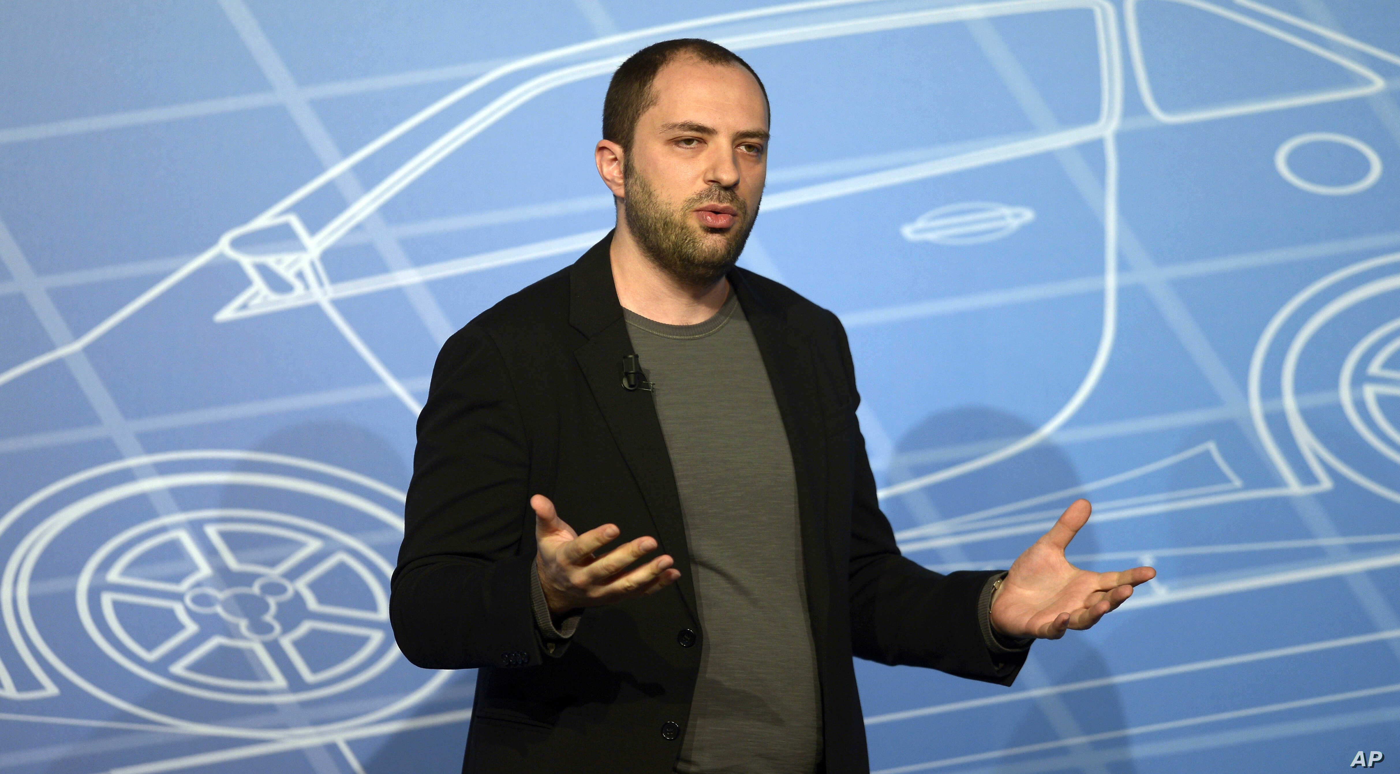FILE - In this Feb. 24, 2014, file photo, WhatsApp co-founder and CEO Jan Koum speaks during a conference at the Mobile World Congress,  in Barcelona, Spain.