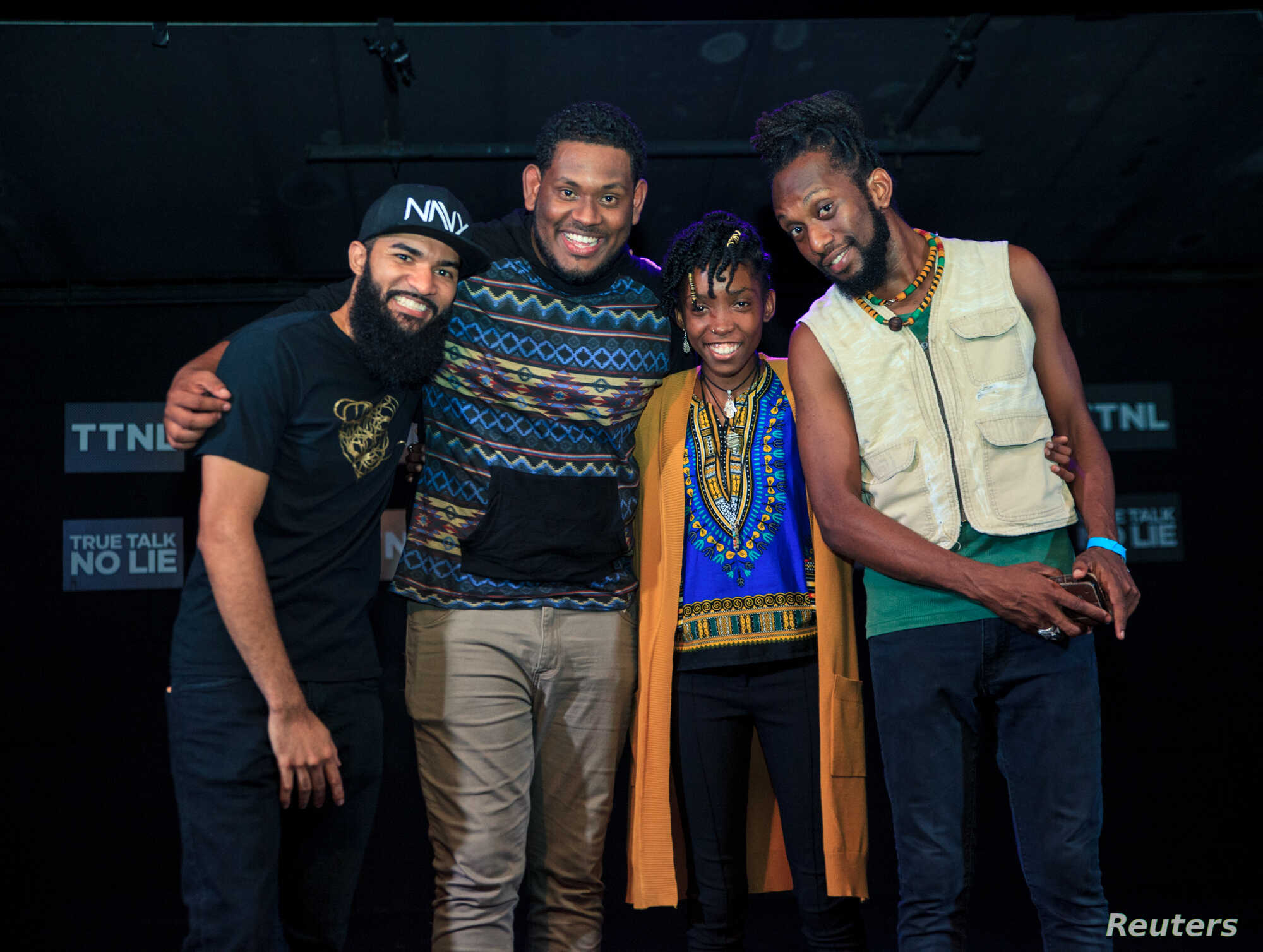 """Host Yvan Mendoza poses with performers Kyle Hernandez, Deneka Thomas, and Idrees Saleem at """"True Talk No Lie"""", a monthly spoken word event in Port of Spain, Trinidad and Tobago, May 23, 2018."""
