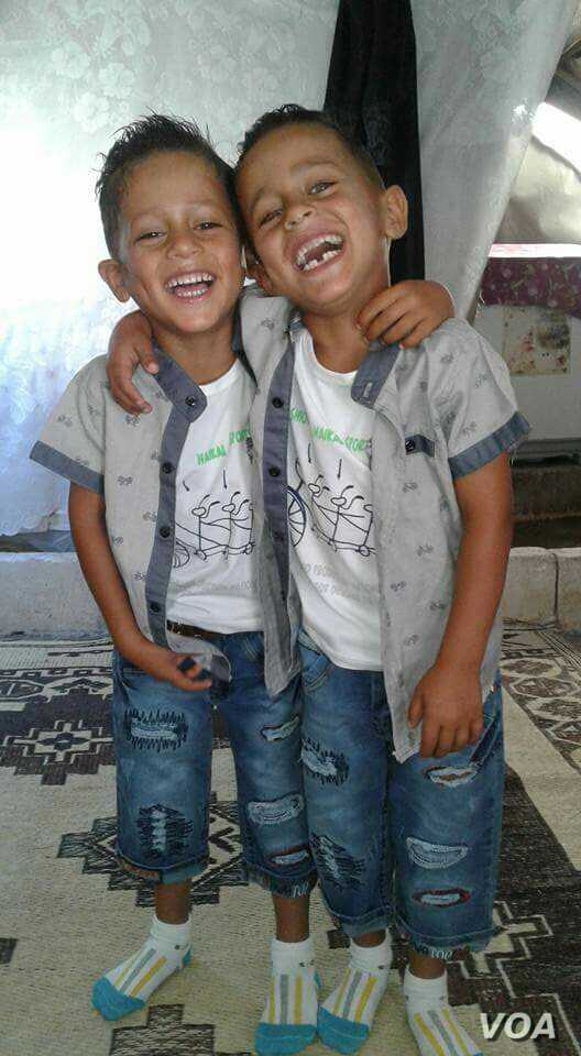 Khaled's mother took this photo of his twin brothers, age 6, in their tent.
