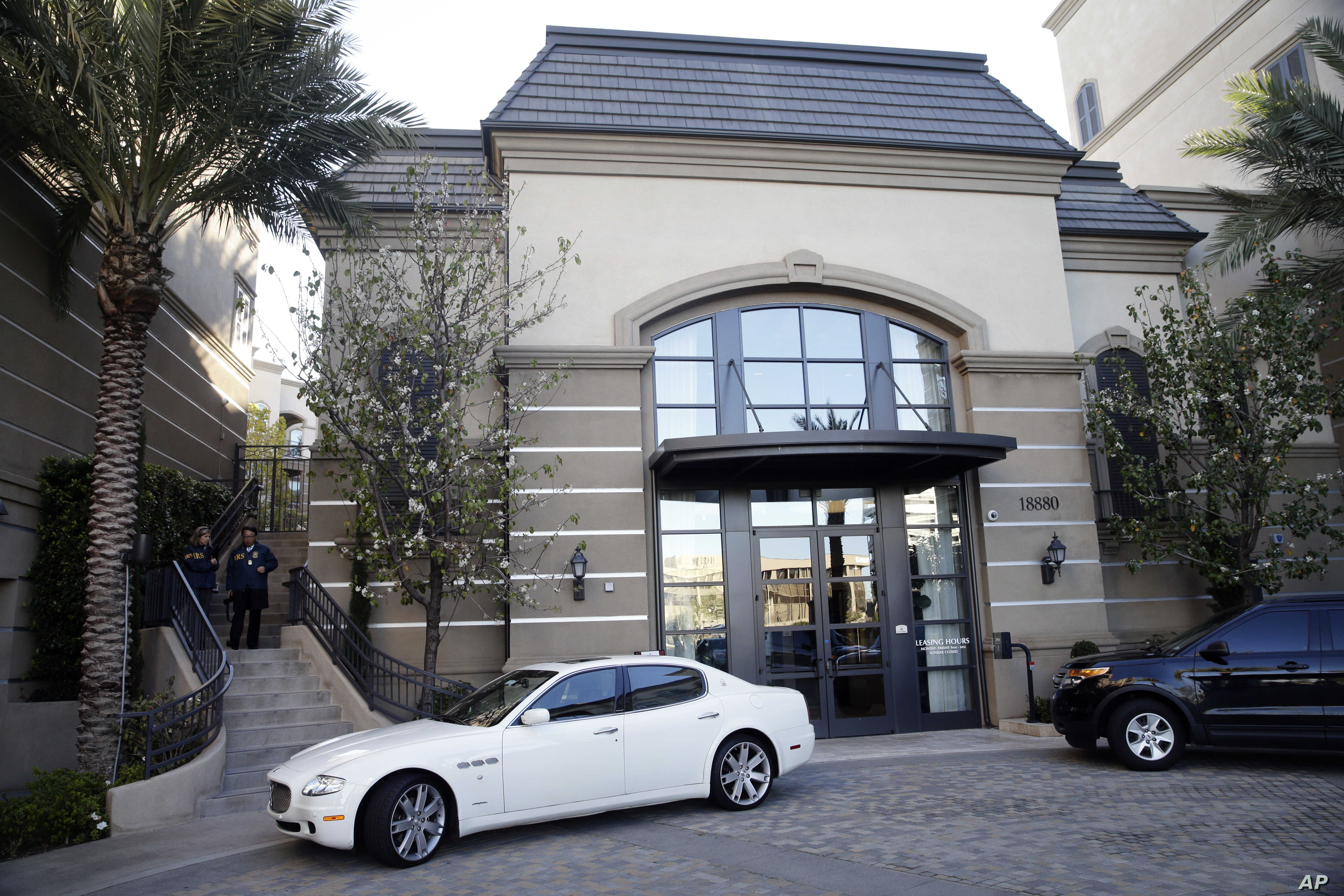 FILE - This March 3, 2015, photo shows an upscale apartment complex where authorities say a birth tourism business charged pregnant women for lodging, food and transportation, after it was raided in Irvine, Calif. On Jan. 31, 2019, authorities announ...