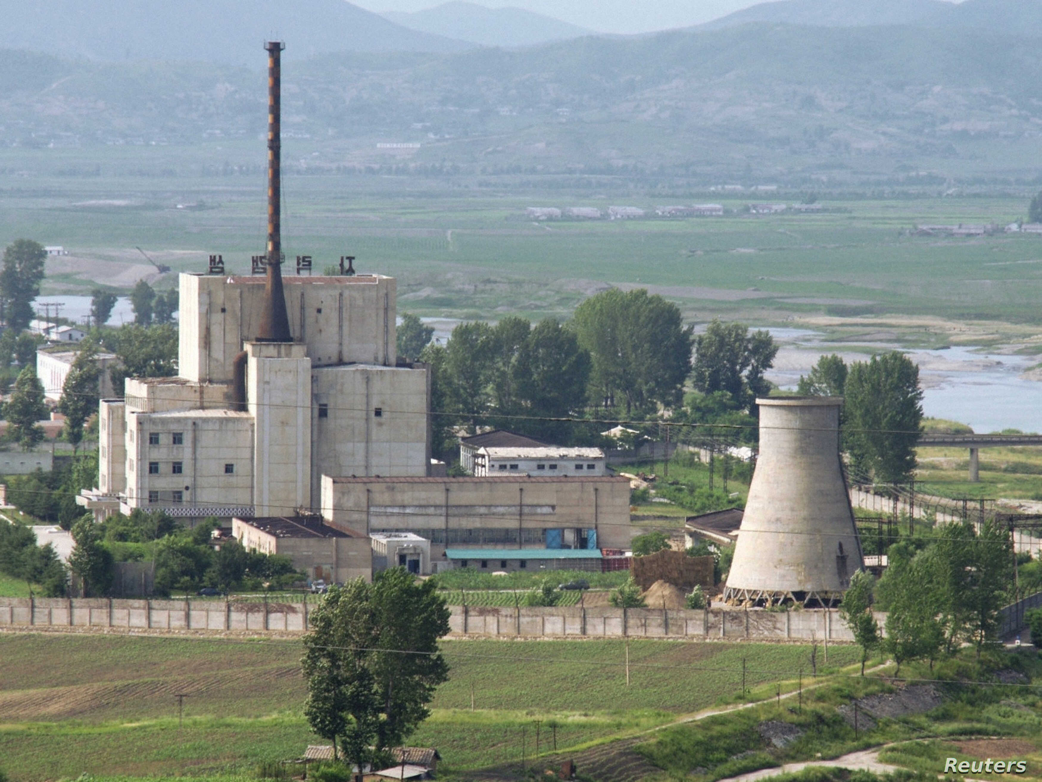 A North Korean nuclear plant is seen before demolishing a cooling tower (R) in Yongbyon, in this photo taken June 27, 2008 and released by Kyodo. North Korea is to restart the mothballed Yongbyon nuclear reactor that has been closed since 2007 in a m...
