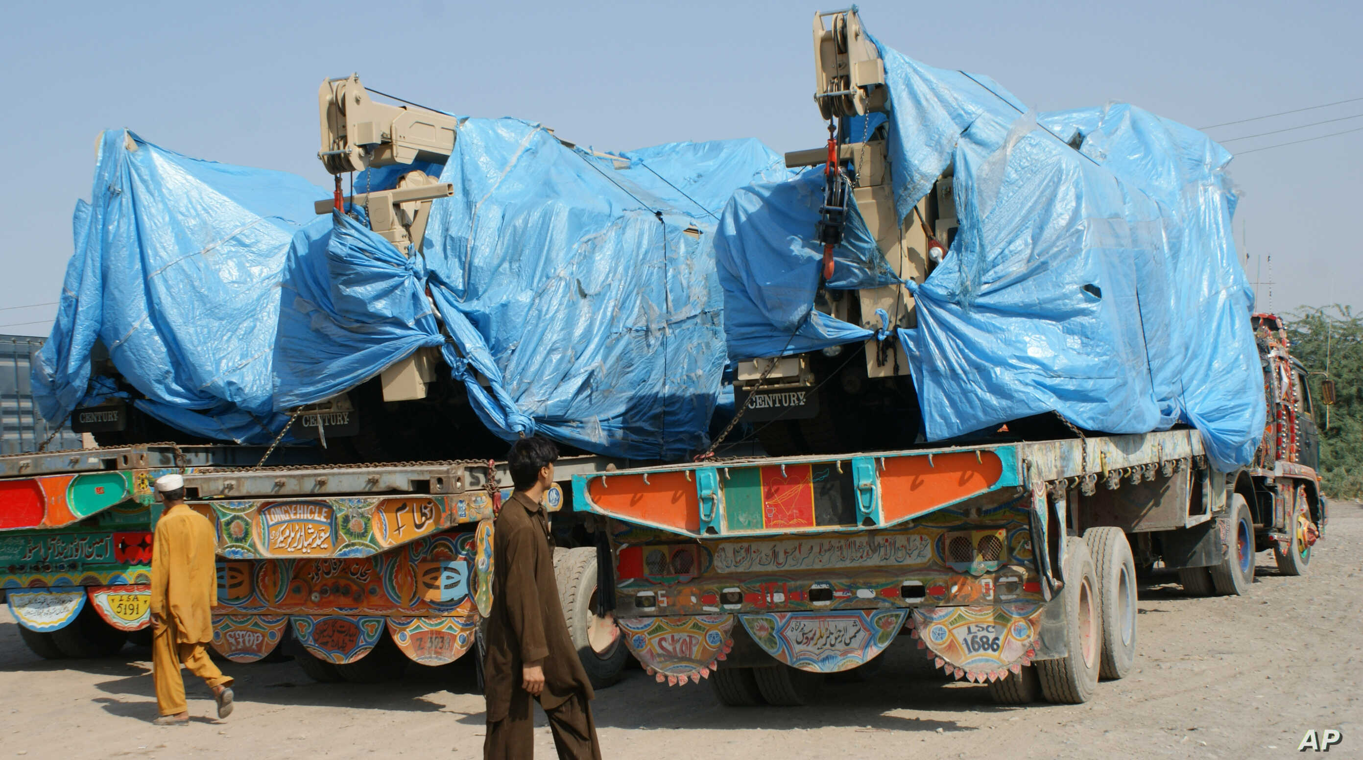 FILE - Afghanistan-bound NATO trucks are parked at a roadside as authorities blocked NATO supply line to Afghanistan after NATO allegedly killed three border guards at Pakistani border, at tribal check post of Takhta Beg in Khyber area of Pakistan ne...