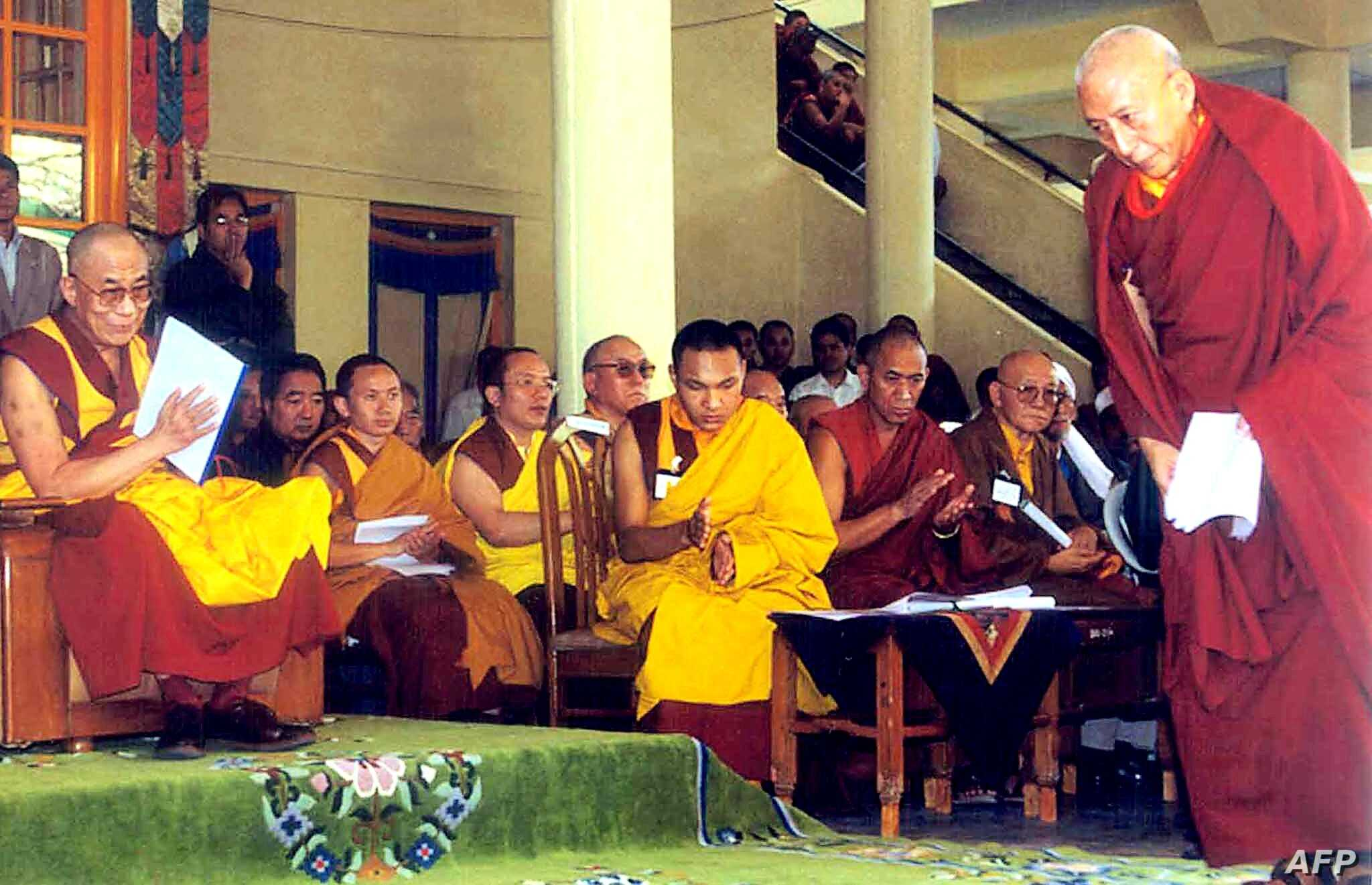 FILE - Tibetan spiritual leader Dalai Lama (L) greets Prime Minister of the Tibetan government-in-exile Samdong Rinpoche (R) during celebrations of the 360th anniversary of the creation of the Tibetan government, in Dharamsala, India, June, 5, 2002. ...