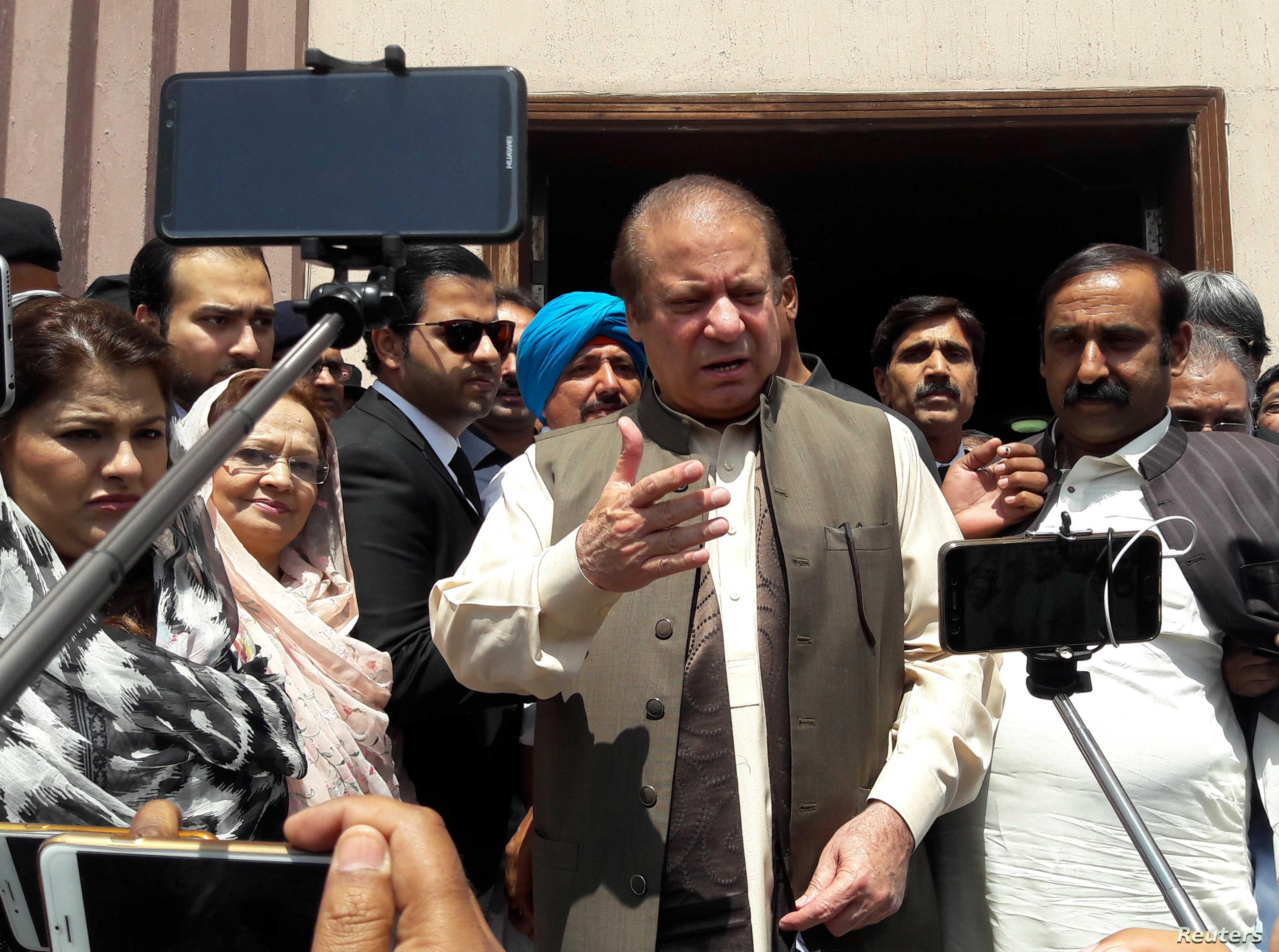 FILE - Pakistan's former Prime Minister Nawaz Sharif talks to media after appearing before the accountability court to face the corruption references filed against him, in Islamabad, Pakistan, April 17, 2018.