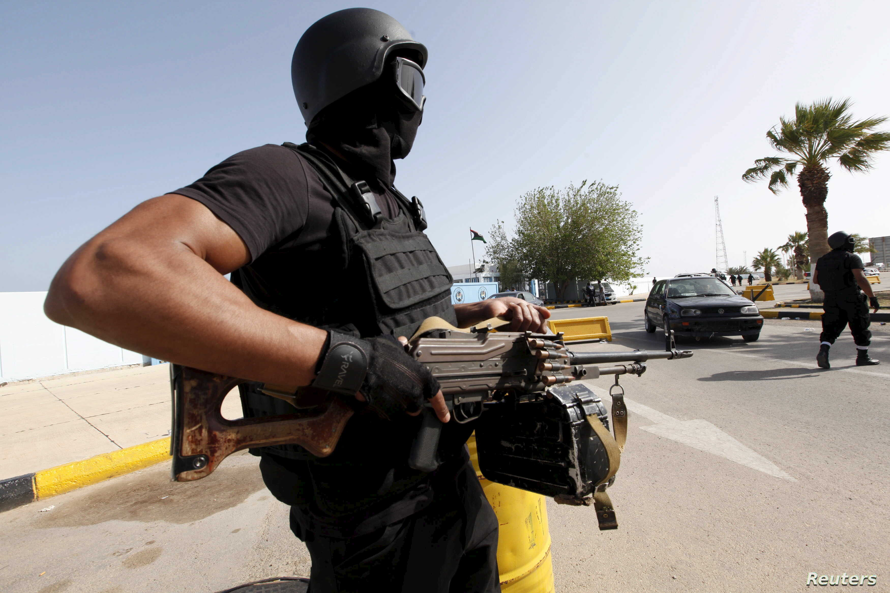 A member of the force assigned to protect Libya's unity government stands at the entrance to where the government has their offices, in Tripoli, Libya, April 14, 2016.