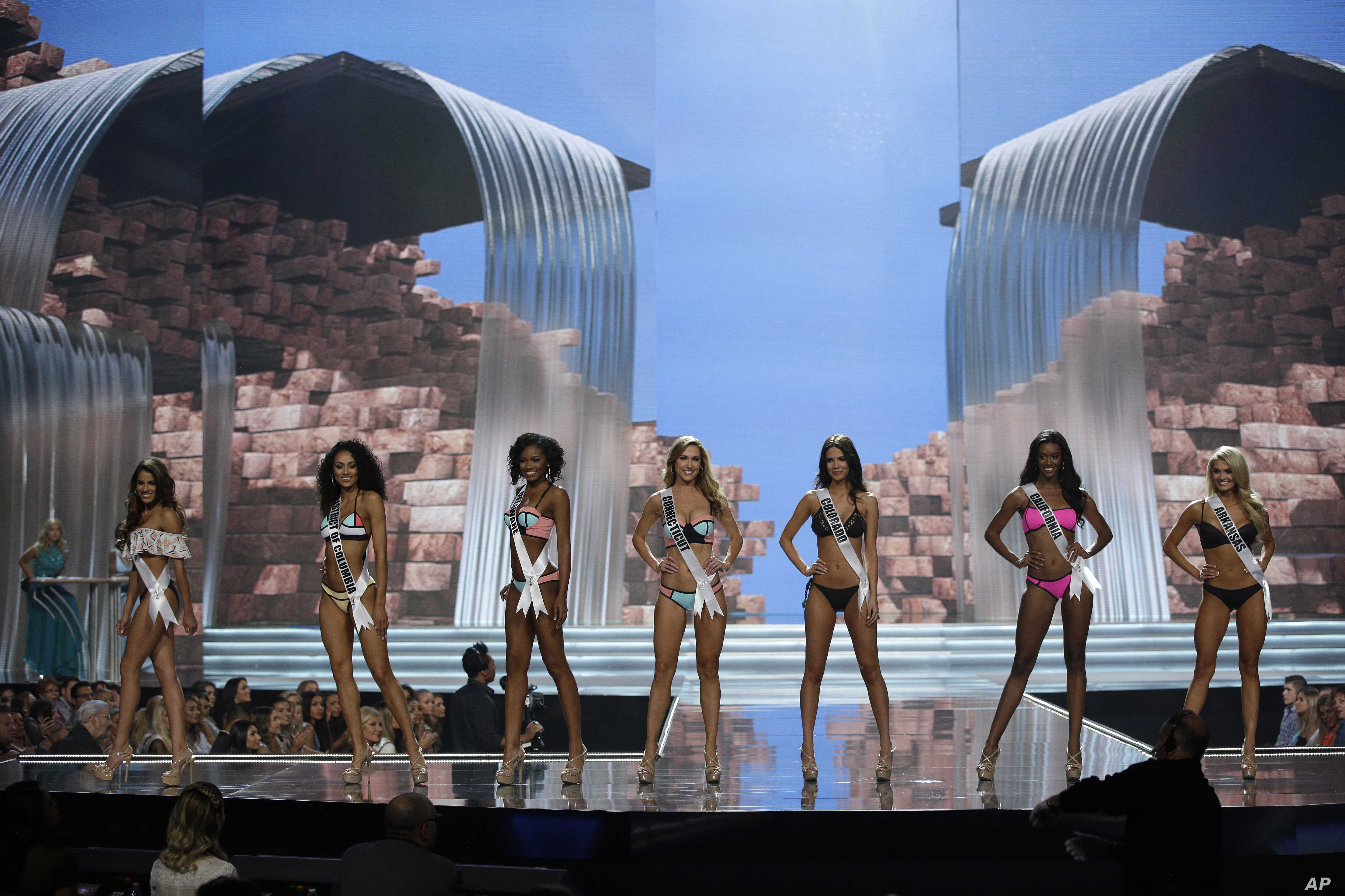 Miss Connecticut USA Olga Litvinenko, center, competes with others during a preliminary competition for Miss USA in Las Vegas, May 11, 2017.