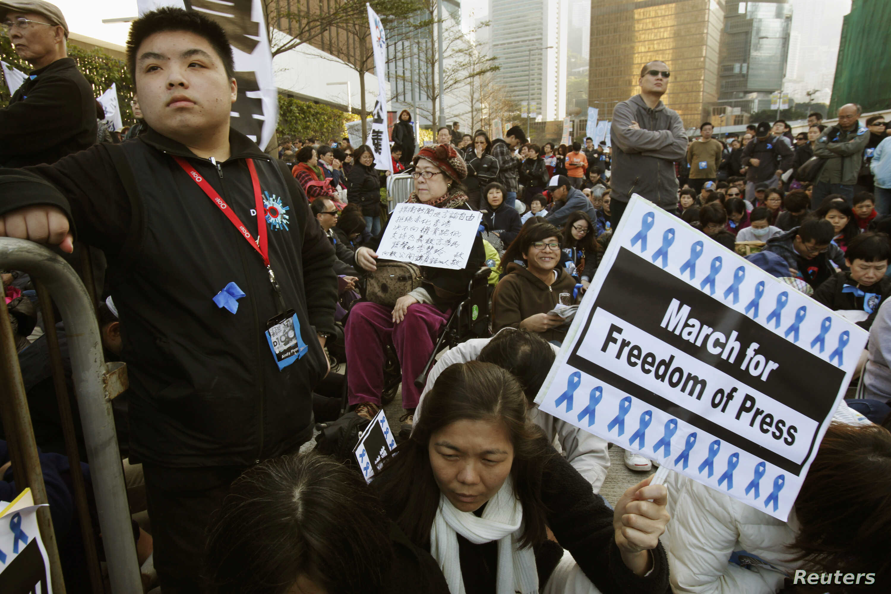 FILE - Protesters sit outside the office of Hong Kong's Chief Executive during a demonstration demanding for freedom of speech and press freedom in Hong Kong.