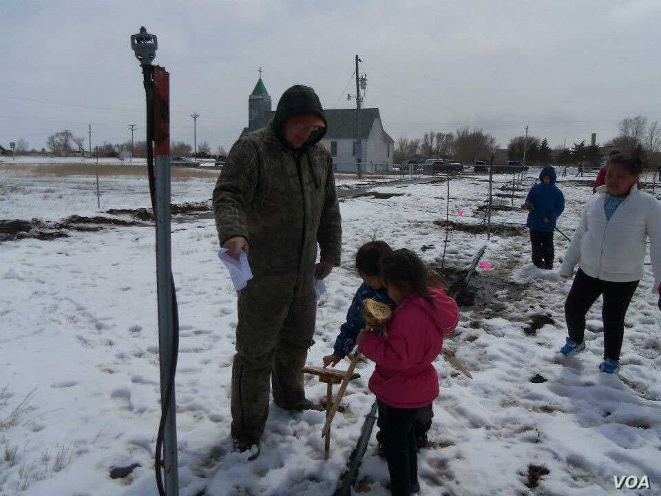 Seen here, residents of the Crow Creek Reservation in Fort Thompson, S.D., planting their first community orchard in Spring 2012. Photo courtesy of Crow Creek Fresh Food Initiative