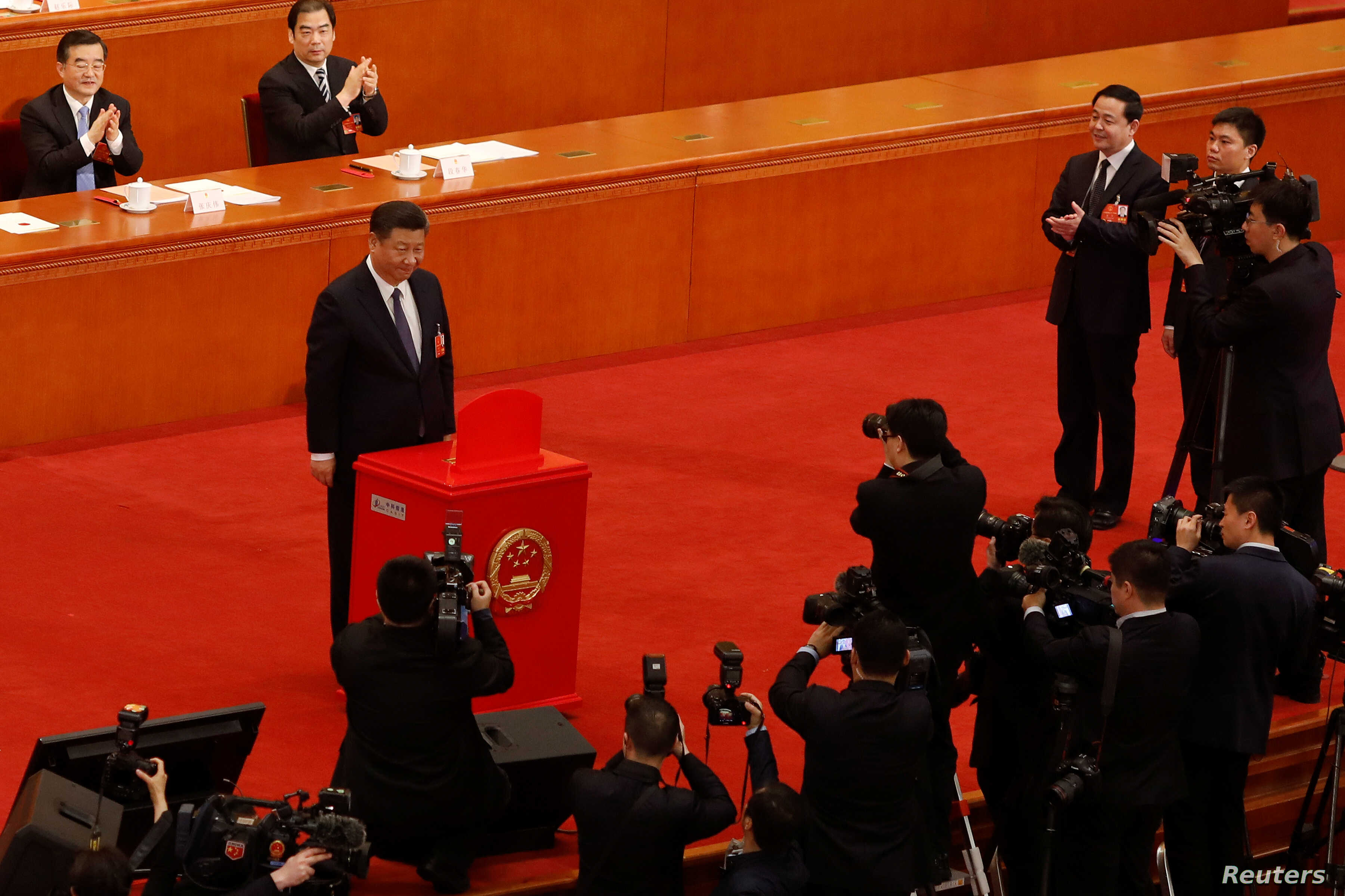 Chinese President Xi Jinping pauses after casting his ballot during a vote on a constitutional amendment lifting presidential term limits, at the third plenary session of the National People's Congress (NPC) at the Great Hall of the People in Beijing...