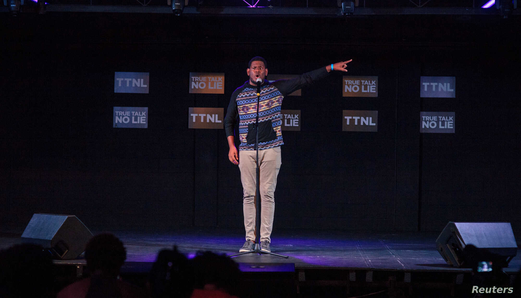"""Kyle Hernandez recites a poem during """"True Talk No Lie"""", a monthly spoken word event in Port of Spain, Trinidad and Tobago, May 23, 2018."""