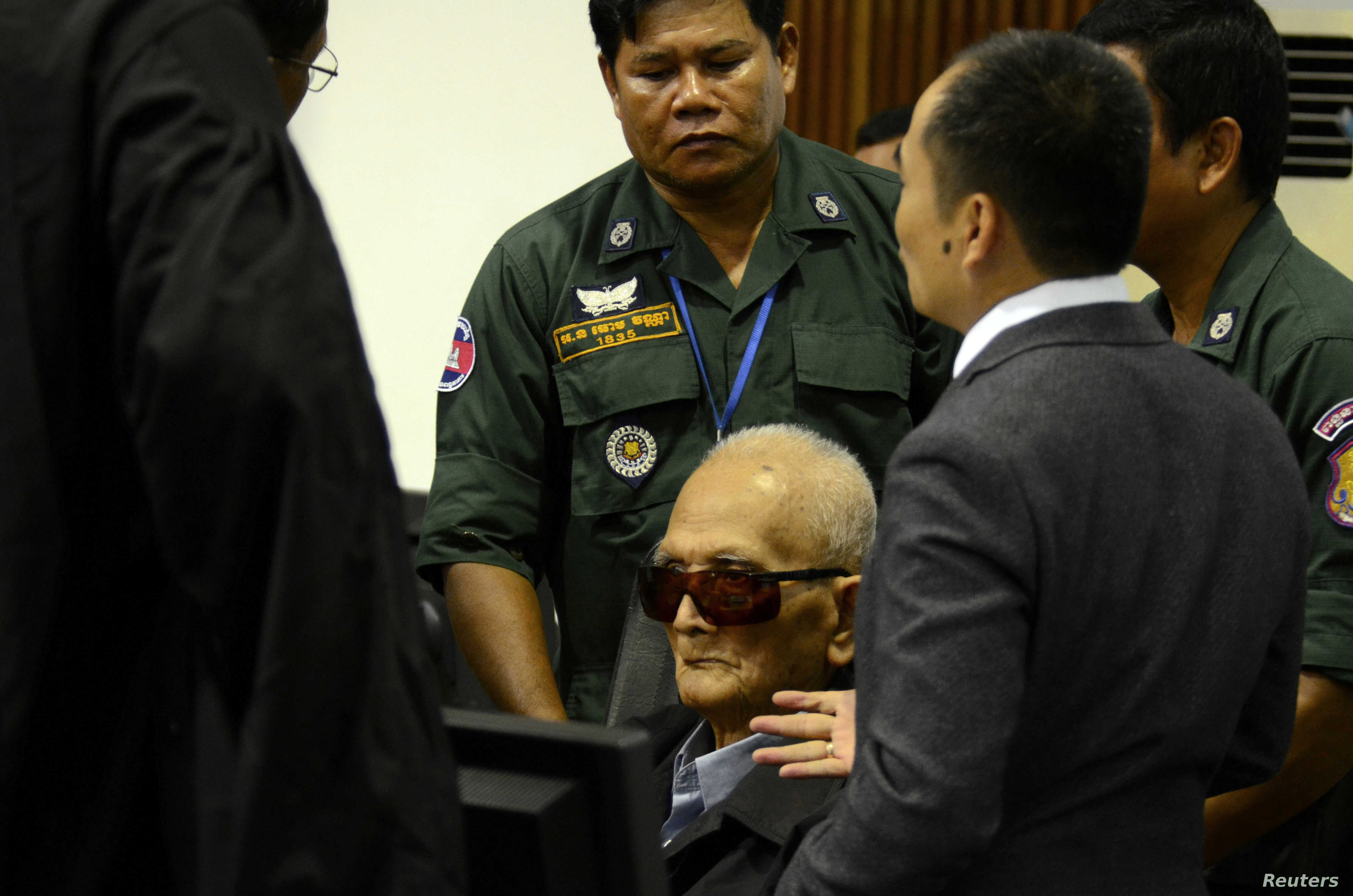 Former Khmer Rouge leader ''Brother Number Two'' Nuon Chea sits inside the courtroom of the Extraordinary Chambers in the Courts of Cambodia (ECCC) as he waits for a verdict, on the outskirts of Phnom Penh, Cambodia, Nov. 16, 2018.