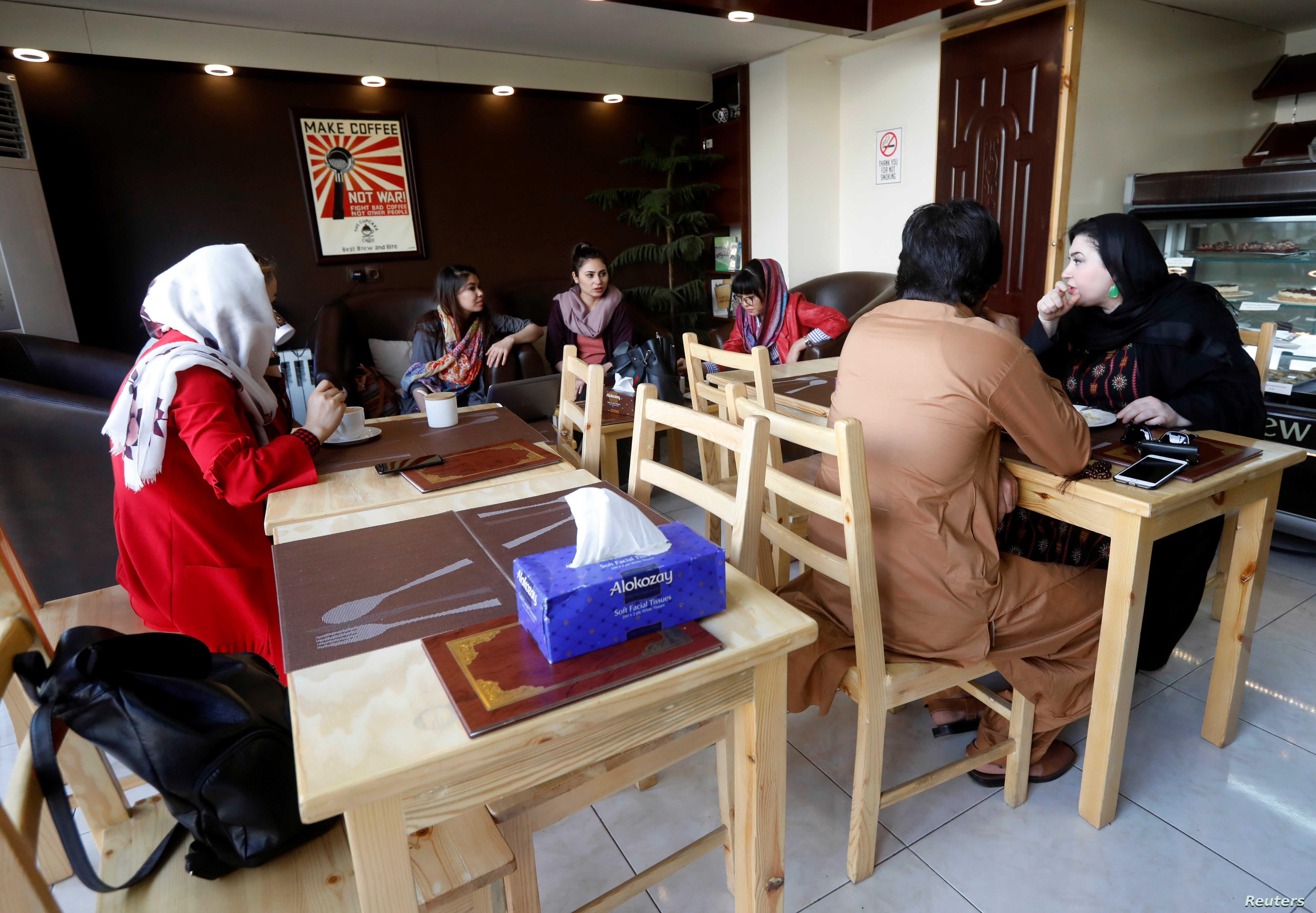 Afghan youths have coffee at a coffee shop in Kabul, Afghanistan June 22, 2018.