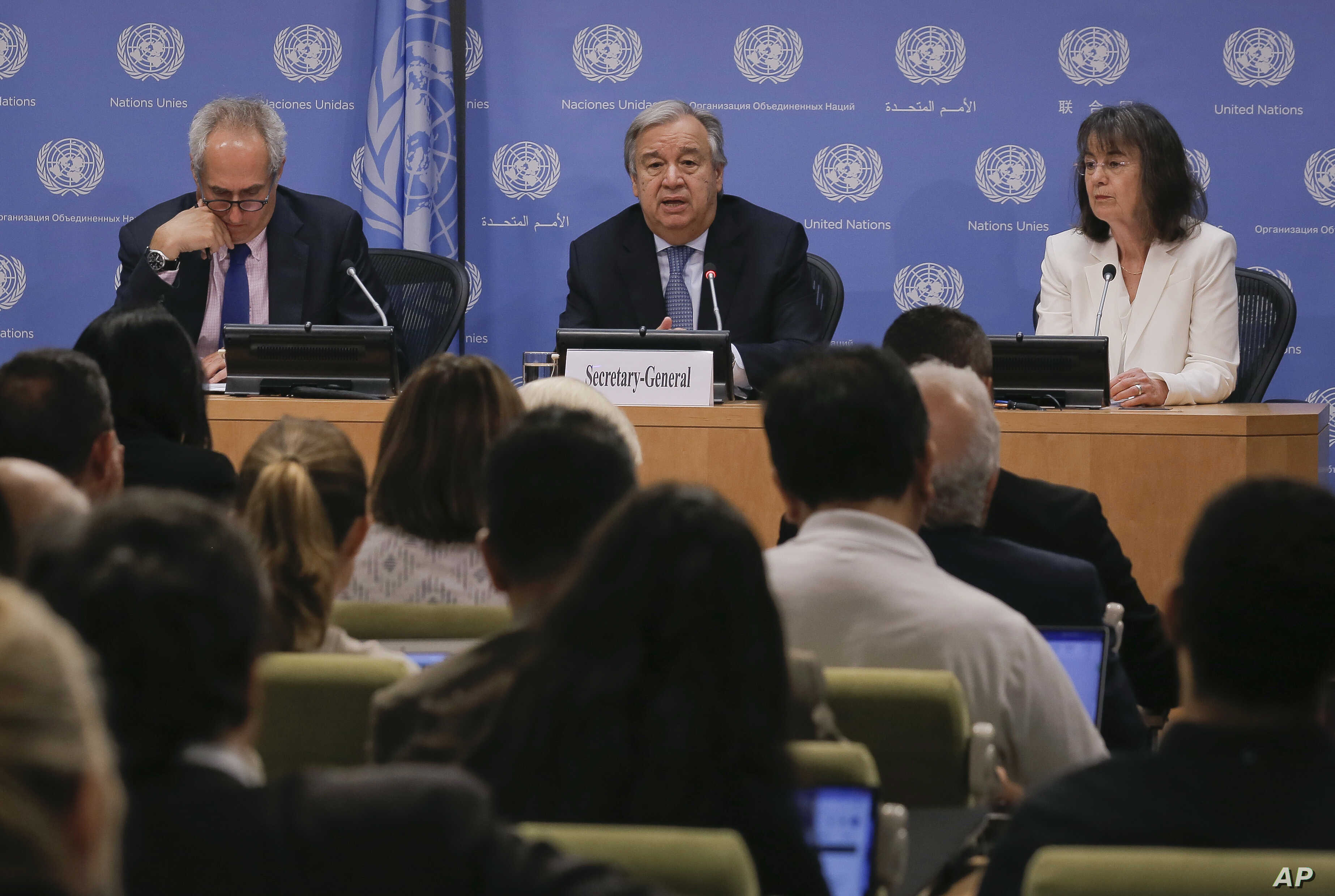 Secretary-General António Guterres, center, accompanied by U.N. spokesman Stéphane Dujarric, left, and Ninette Kelley, director of the U.N. High Commissioner for Refugees, speaks to U.N. correspondents on World Refugee Day at U.N. headquarters in N...