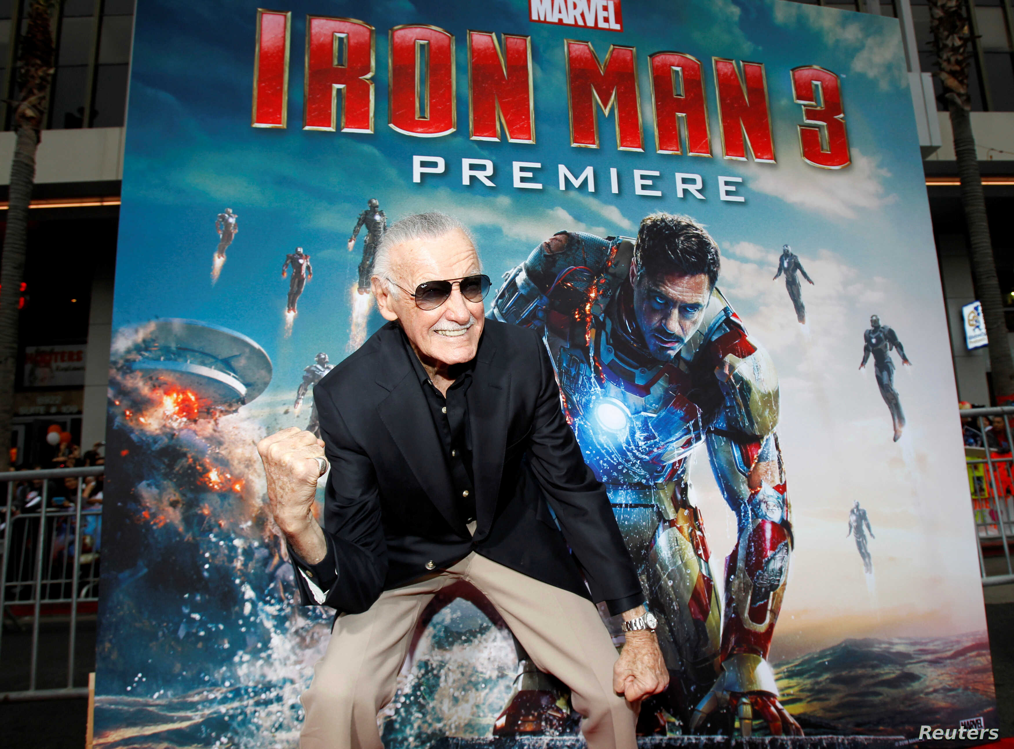 """FILE PHOTO: Stan Lee gestures as he poses at the premiere of """"Iron Man 3"""" at El Capitan Theater in Hollywood, California, U.S., April 24, 2013."""