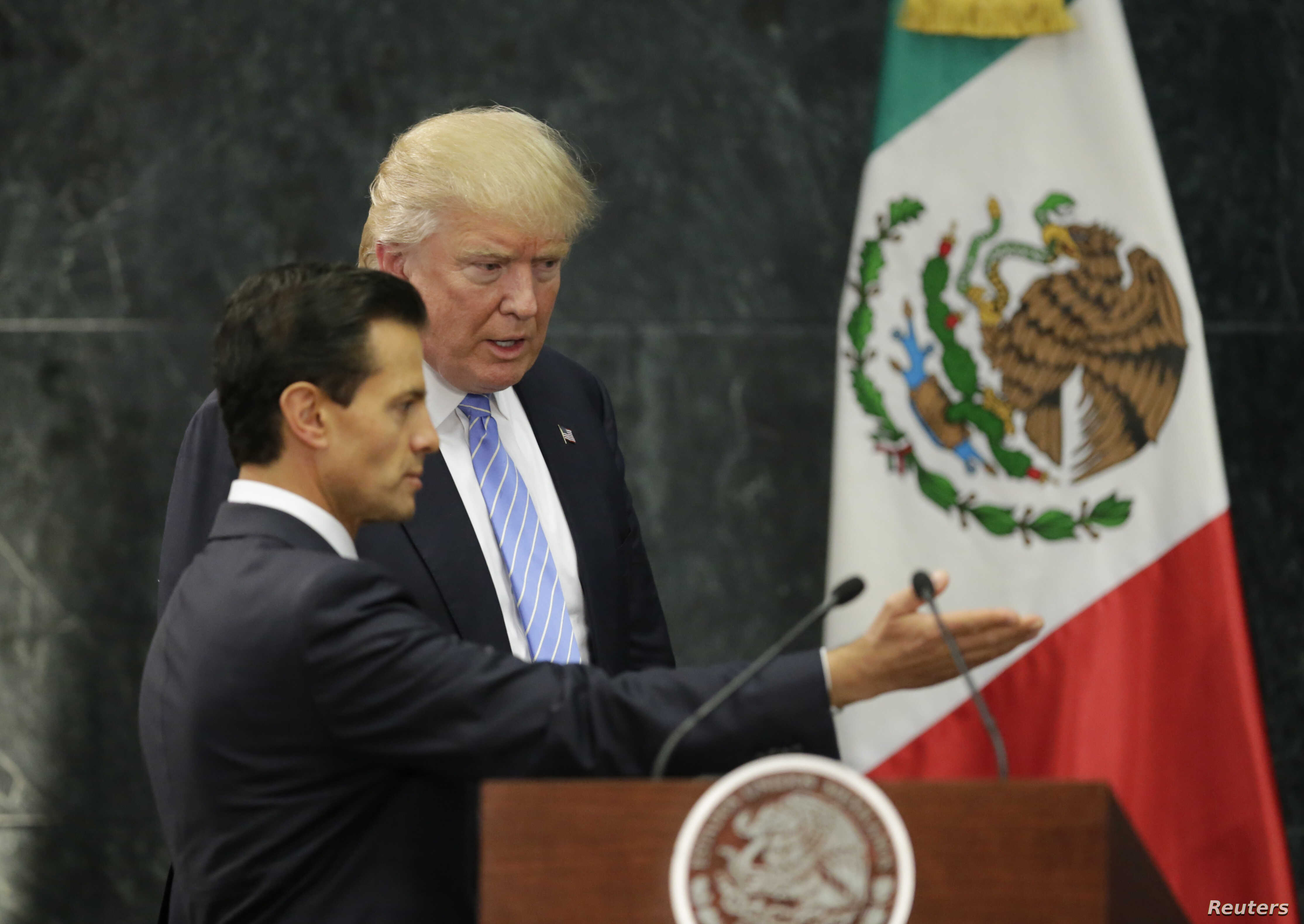 U.S. Republican presidential nominee Donald Trump and Mexico's President Enrique Pena Nieto arrive for a press conference at the Los Pinos residence in Mexico City, Mexico, Aug. 31, 2016.