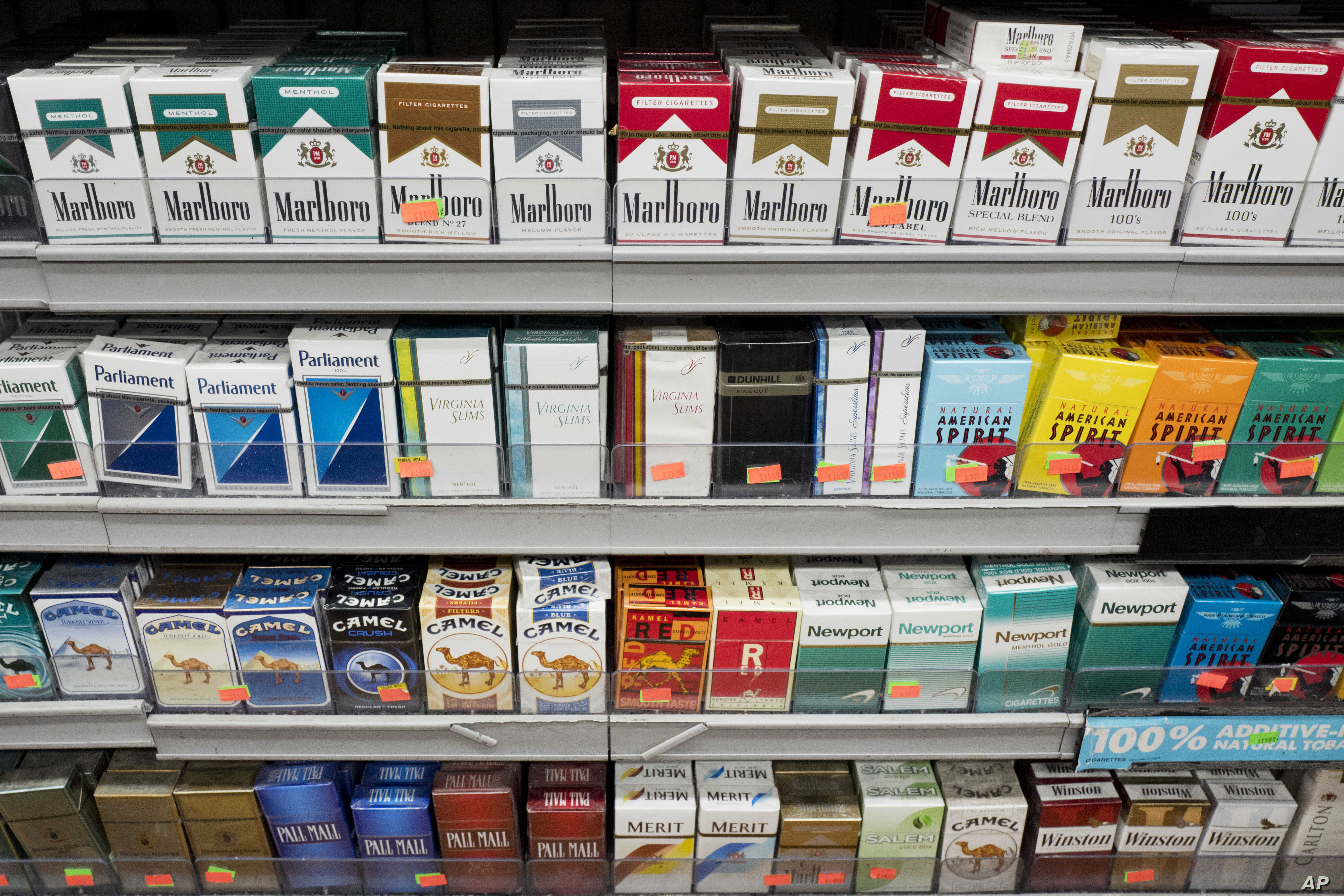 Cigarettes are displayed on a shelf in New York, Aug. 28, 2017.