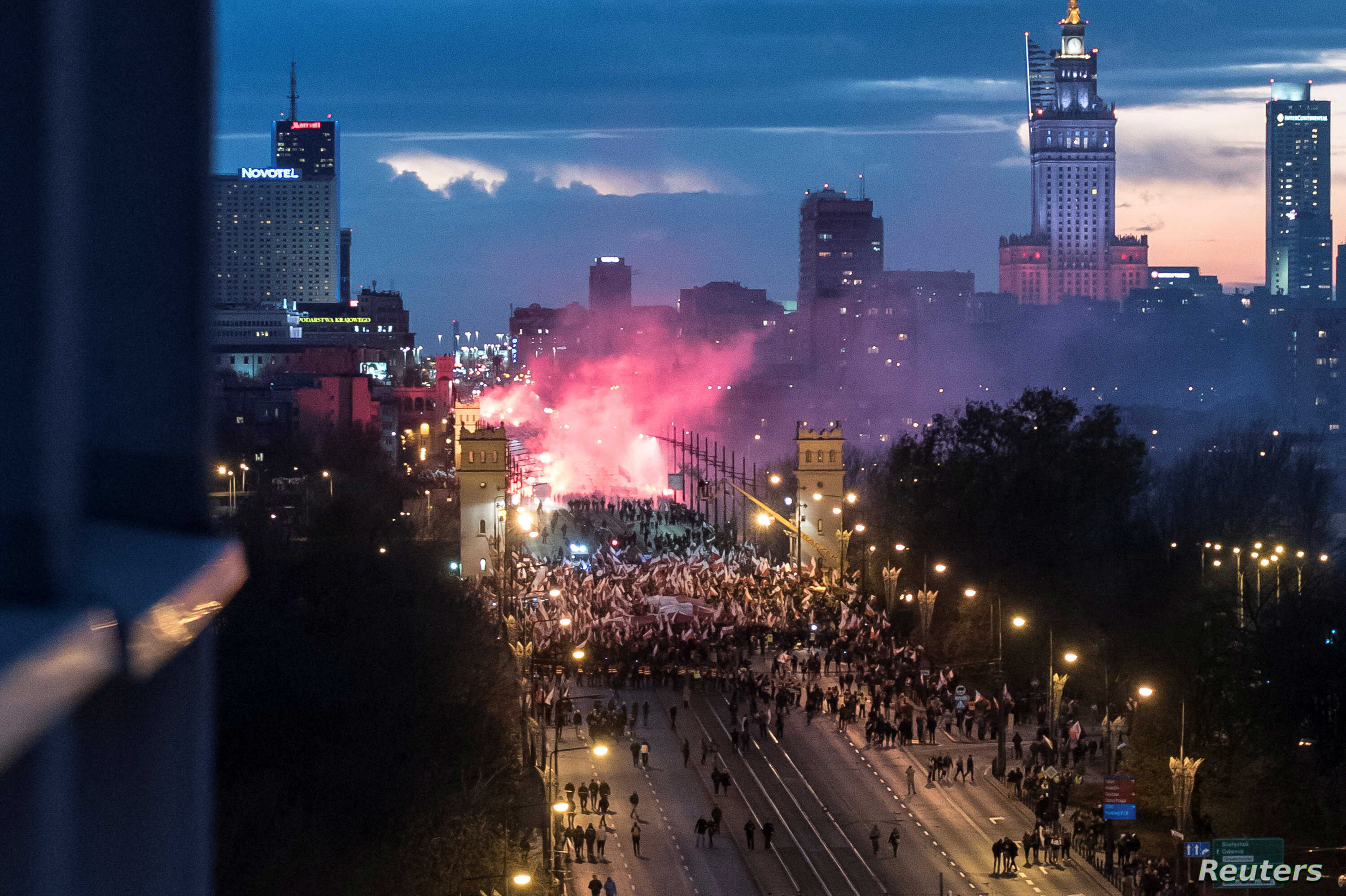 Protesters march during a rally, organized by far-right, nationalist groups, to mark 99th anniversary of Polish independence in Warsaw,  Nov.11, 2017.