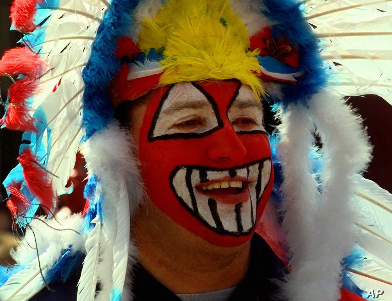 FILE - Mike Margevicus, a fan of the Cleveland Indians Baseball team, waiting to enter Jacobs Field for the team's home opener Friday, April 10, 1998, in Cleveland, Ohio. Nearby demonstrators protested the Indians mascot, Chief Wahoo, as racist.