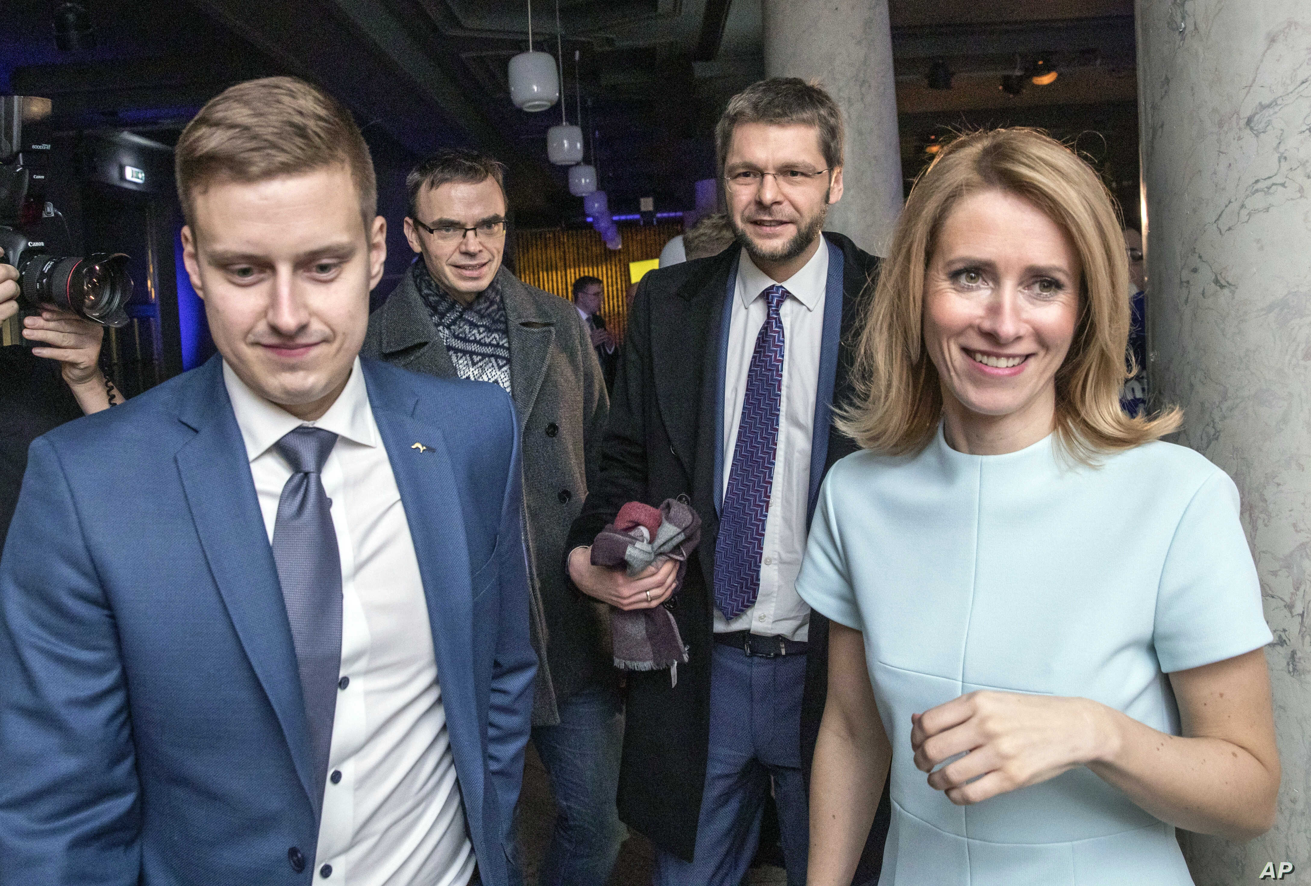 From the left: Reform party Party's secretary-general Erkki Keldo, Sven Mikser from Social Democrates, Jevgeni Ossinovski, leader of Social Democrates and Kaja Kallas pose for a photo after parliamentary elections in Tallinn, Estonia, early March 4, ...