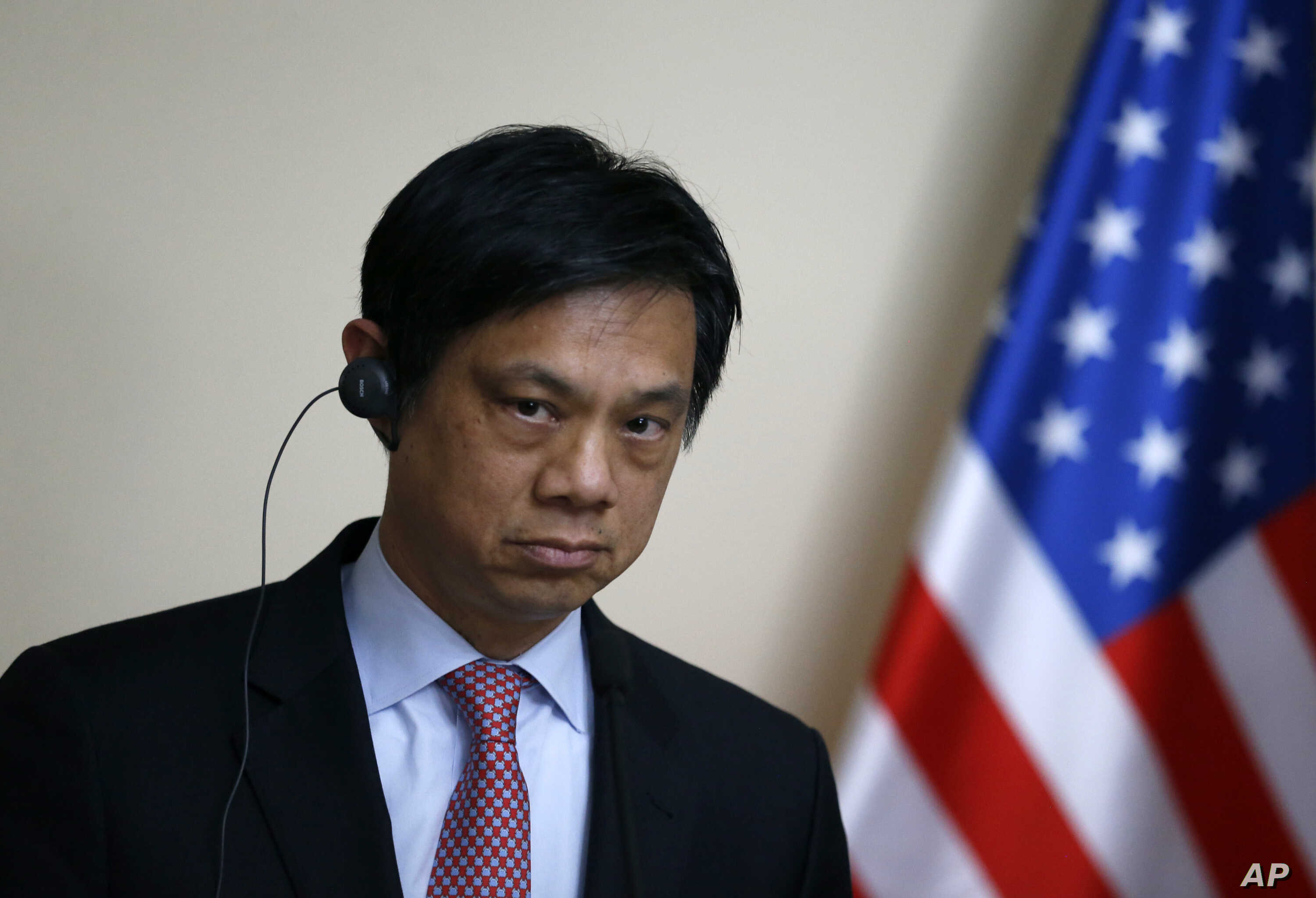 Hoyt Brian Yee, Deputy Assistant Secretary for European and Eurasian Affairs, listens as Serbian Prime Minister Aleksandar Vucic speaks during a shared news conference, in Belgrade, May 24, 2017.